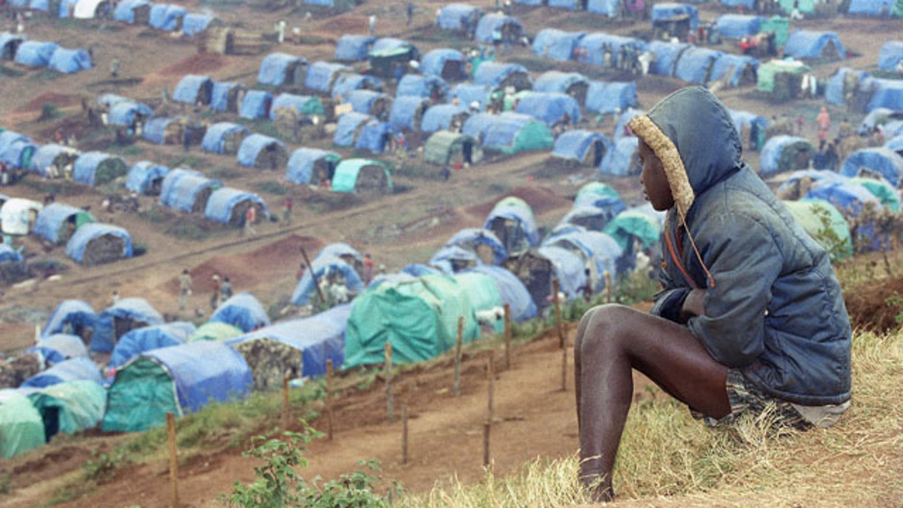 FILE - In this Aug. 25, 1994 file photo a young Tutsi refugee gazes upon the Tutsi camp of Nyarushishi, Rwanda, 6 miles southeast of Cyangugu. Two decades after the Rwandan genocide, France is finally opening what critics called its blind eye to justice over the killings. (AP)