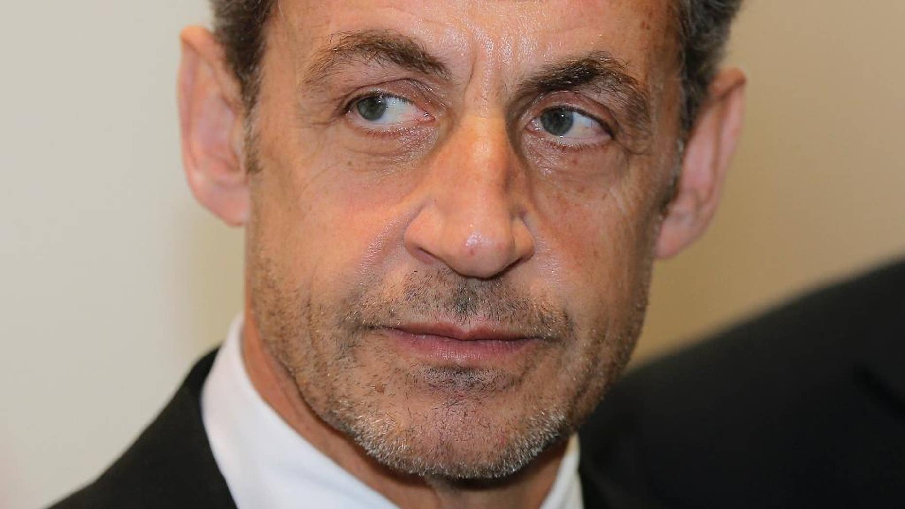 FILE - This Monday, March 10, 2014, file photo shows former French President Nicolas Sarkozy at the Foundation Claude Pompidou, in Nice, French Riviera. Former French President Nicolas Sarkozy has been detained and is reportedly being questioned by financial investigators in a corruption probe that is rattling France's conservative political establishment. (AP Photo/Lionel Cironneau, File)