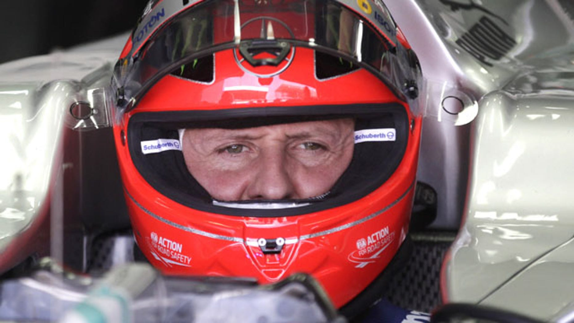 FILE - In this Nov. 23, 2012 file photo, Grand Prix driver Michael Schumacher, of Germany, sits in his car during a free practice at the Interlagos race track in Sao Paulo, Brazil. (AP)