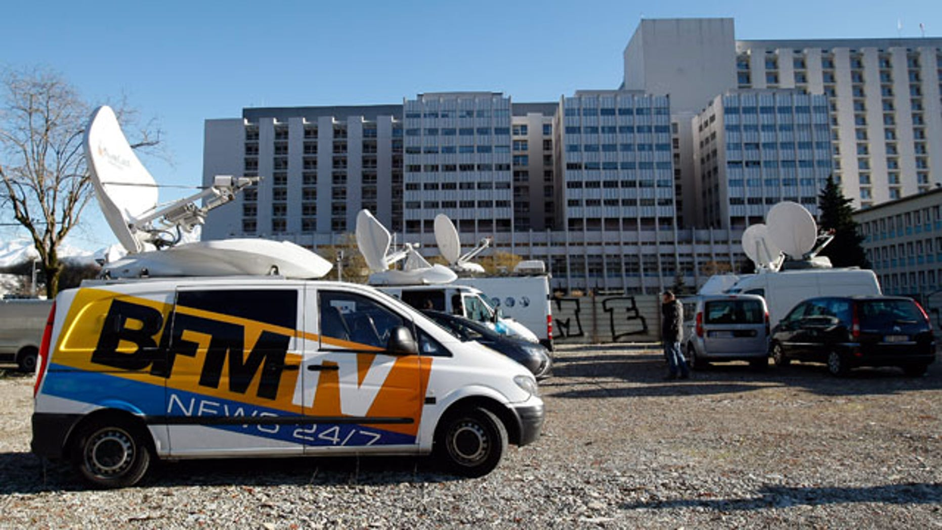 January 5, 2014: A TV van is parked in front of the Grenoble hospital where former seven-time Formula One champion Michael Schumacher is being treated after sustaining a head injury during a ski accident. (AP Photo/Claude Paris)