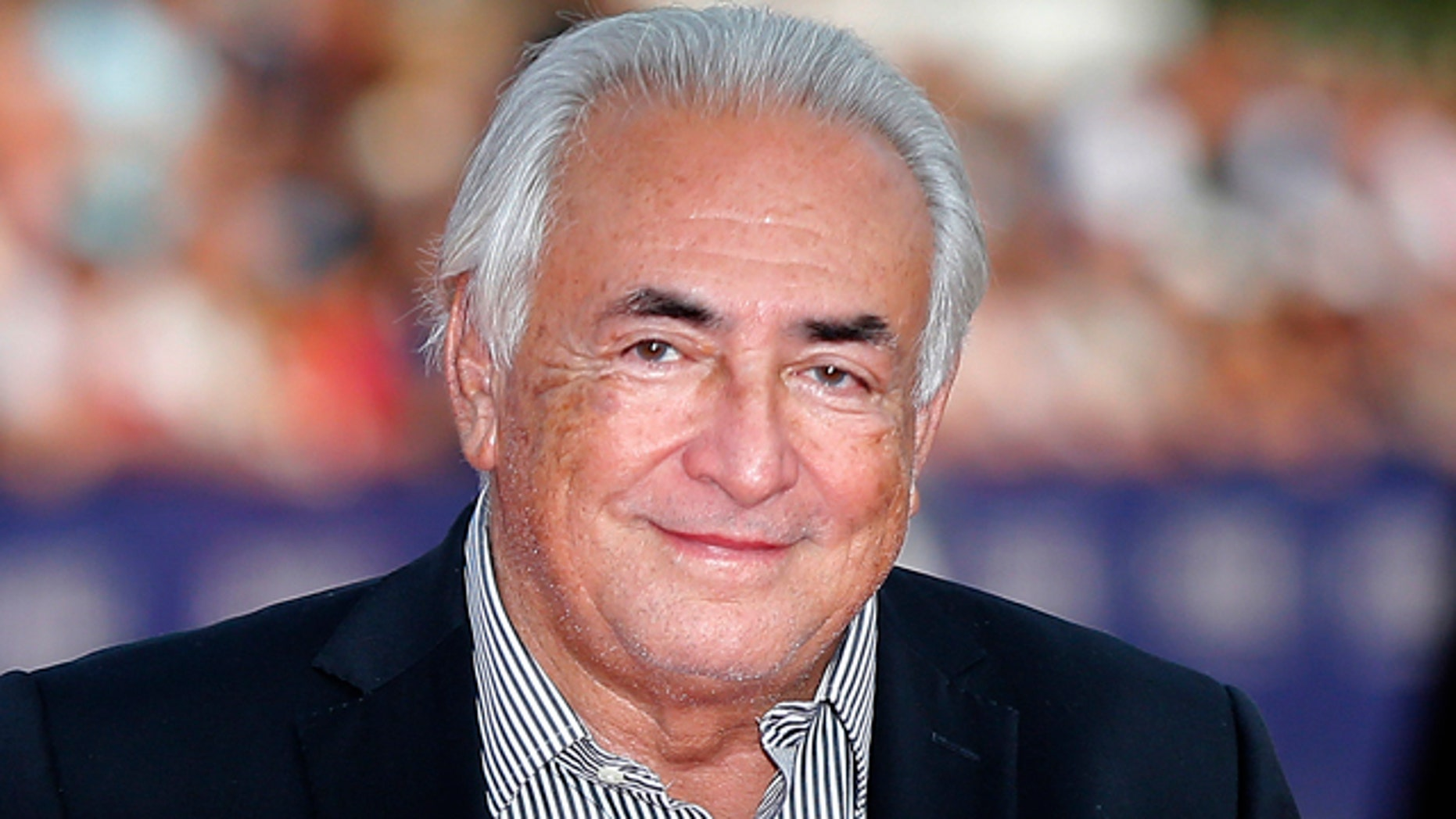 FILE - This Saturday, Sept. 13, 2014, file photo shows former IMF Secretary General Dominique Strauss-Kahn arriving for the award ceremony at the 40th American Film Festival in Deauville, Normandy, western France. (AP Photo/Jacques Brinon, File)