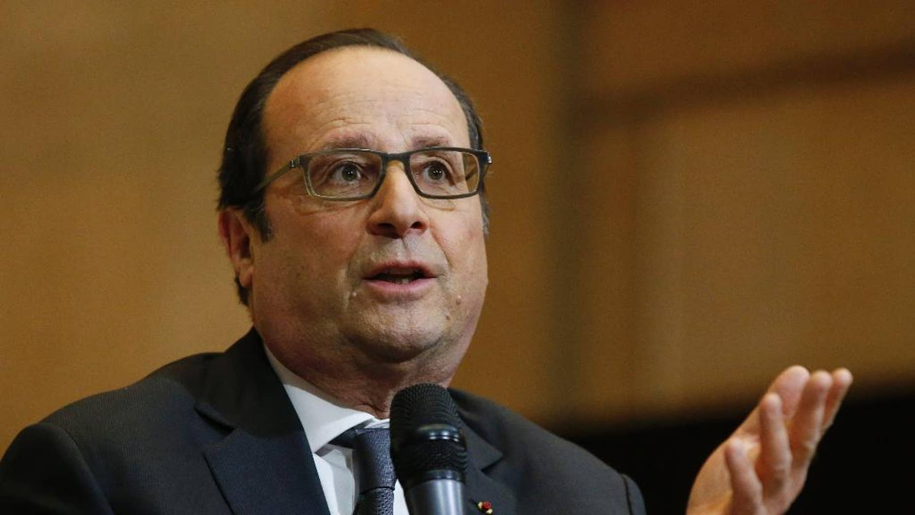 France's President Francois Hollande speaks to students at the economic and social council in Paris, France, Wednesday, May 6, 2015. (AP Photo/Michel Euler, Pool)