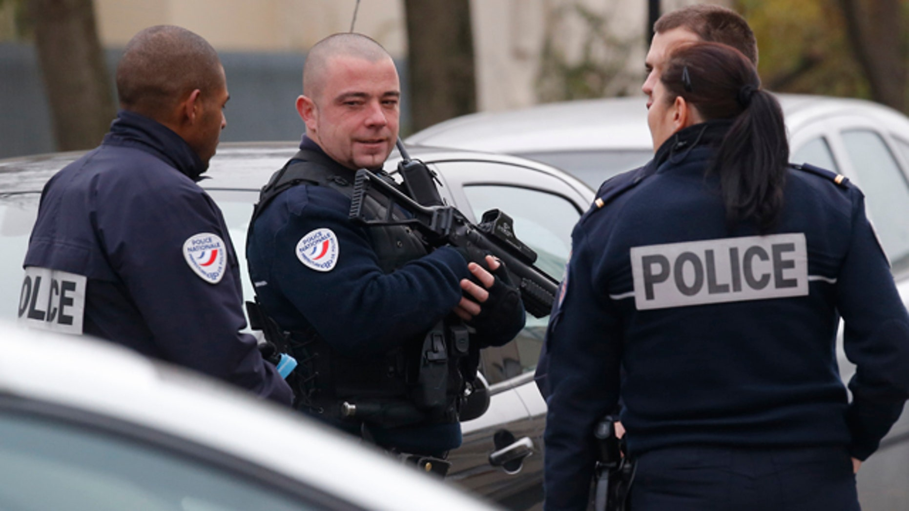 Dec. 14, 2015: Police officers patrol near a preschool, after a masked assailant with a box-cutter and scissors who mentioned the Islamic State group attacked a teacher in the Paris suburb of Aubervilliers.