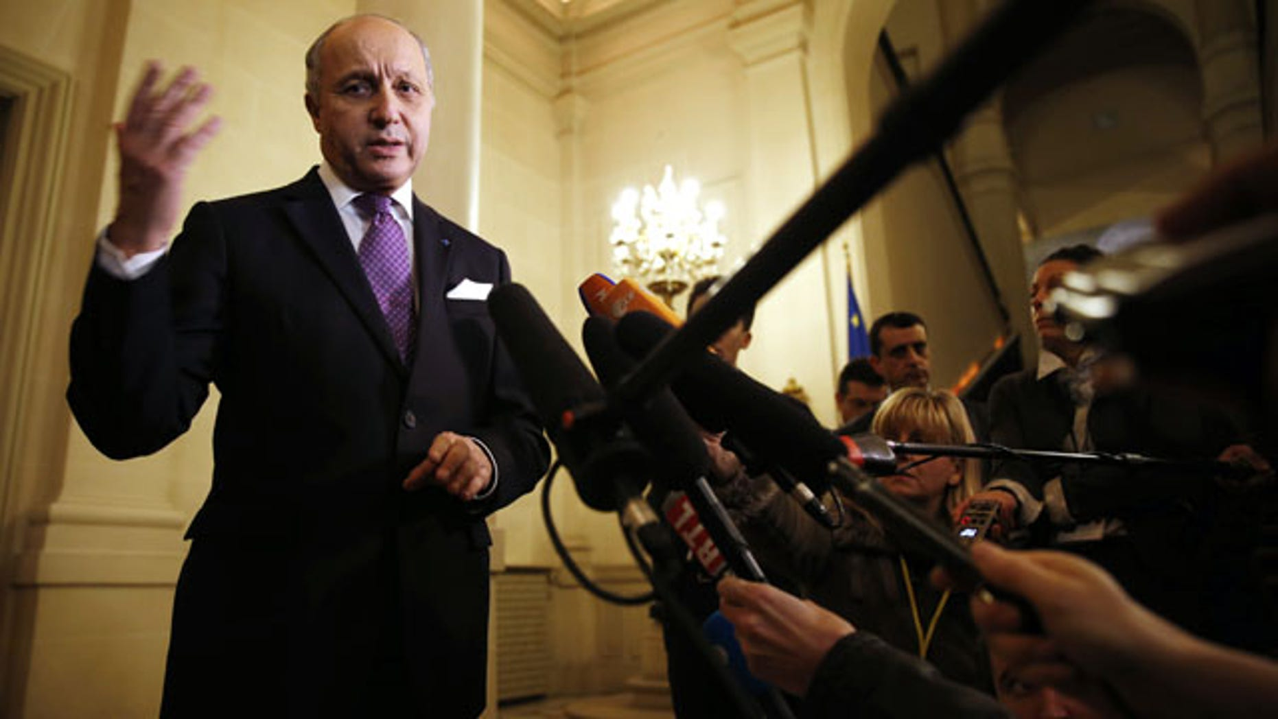 March 5, 2014: French Foreign Minister Laurent Fabius speaks to reporters after a meeting on the Ukraine crisis with U.S. Secretary of State John Kerry and other foreign ministers at the Quai d' Orsay in Paris. (AP Photo / Kevin Lamarque, pool)