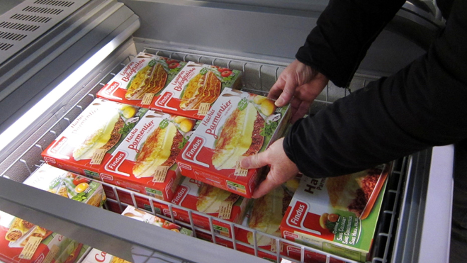 Feb. 11, 2013: A customer takes a pack of frozen beef Hachis Parmentier from a freezer in a supermarket in Nice, southeastern France.