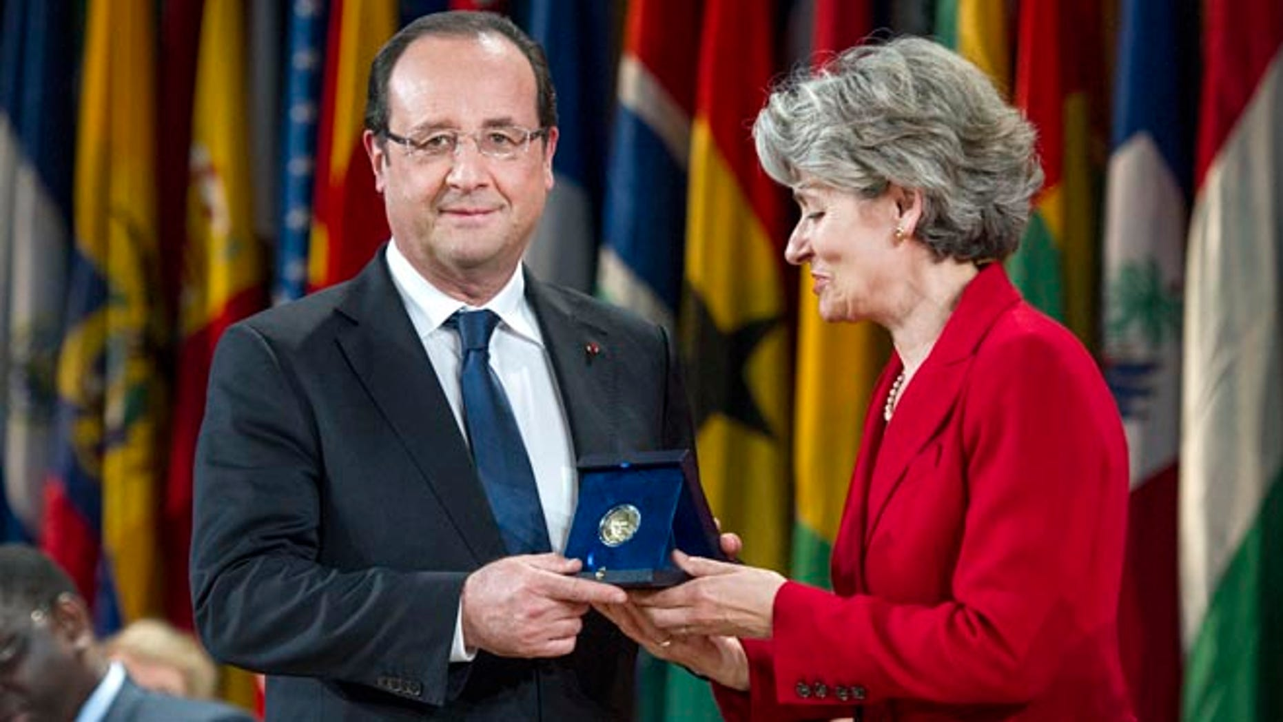 June 5, 2013: French President Francois Hollande receives the Felix Houphouet-Boigny Peace Prize from Director-General of UNESCO Irina Bokova, right,  at the UNESCO headquarters in Paris, France.