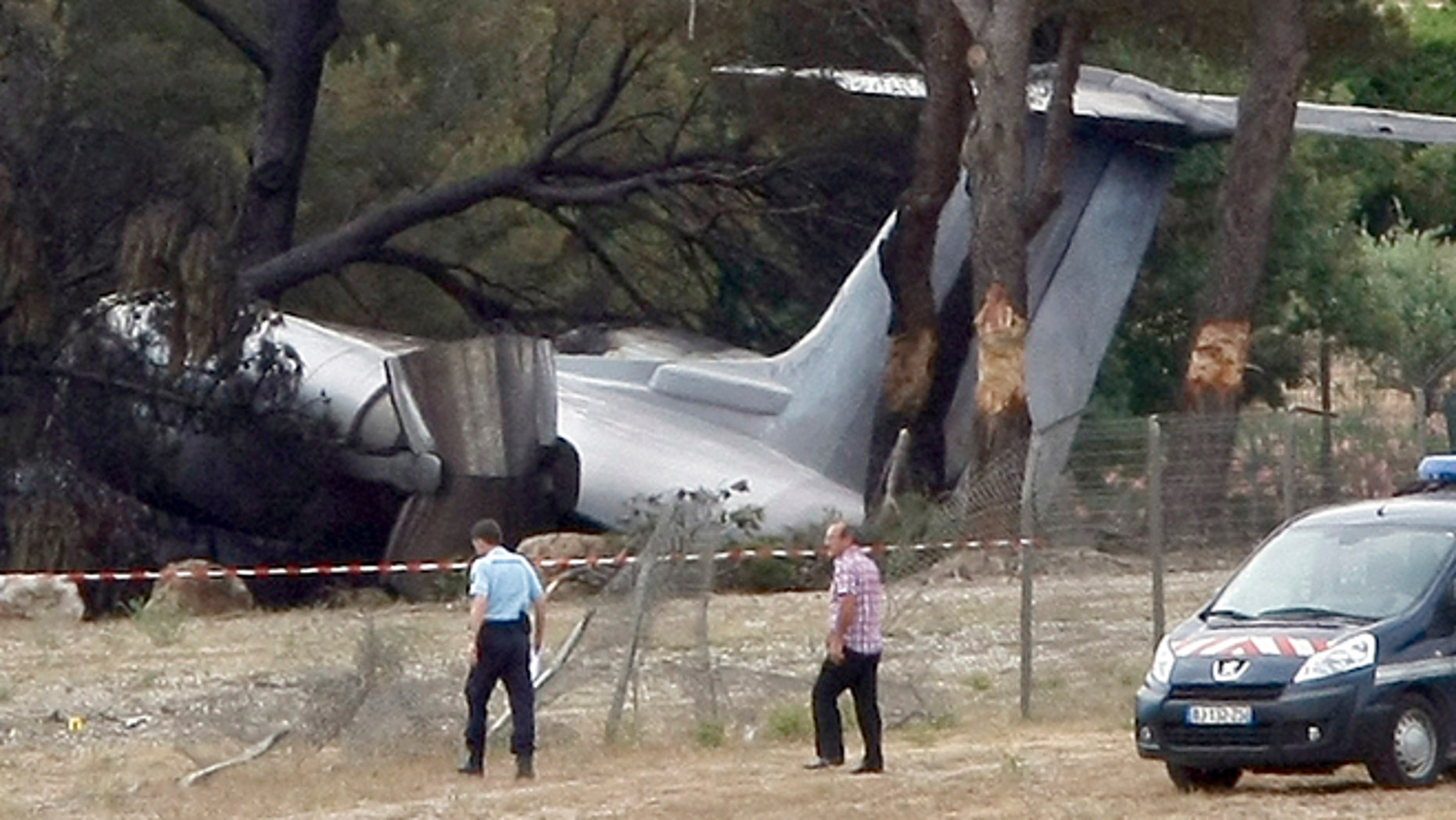 July 13: Police Officers walk near the plane that crashed on landing at Le Castellet airport, near Toulon, southern France.