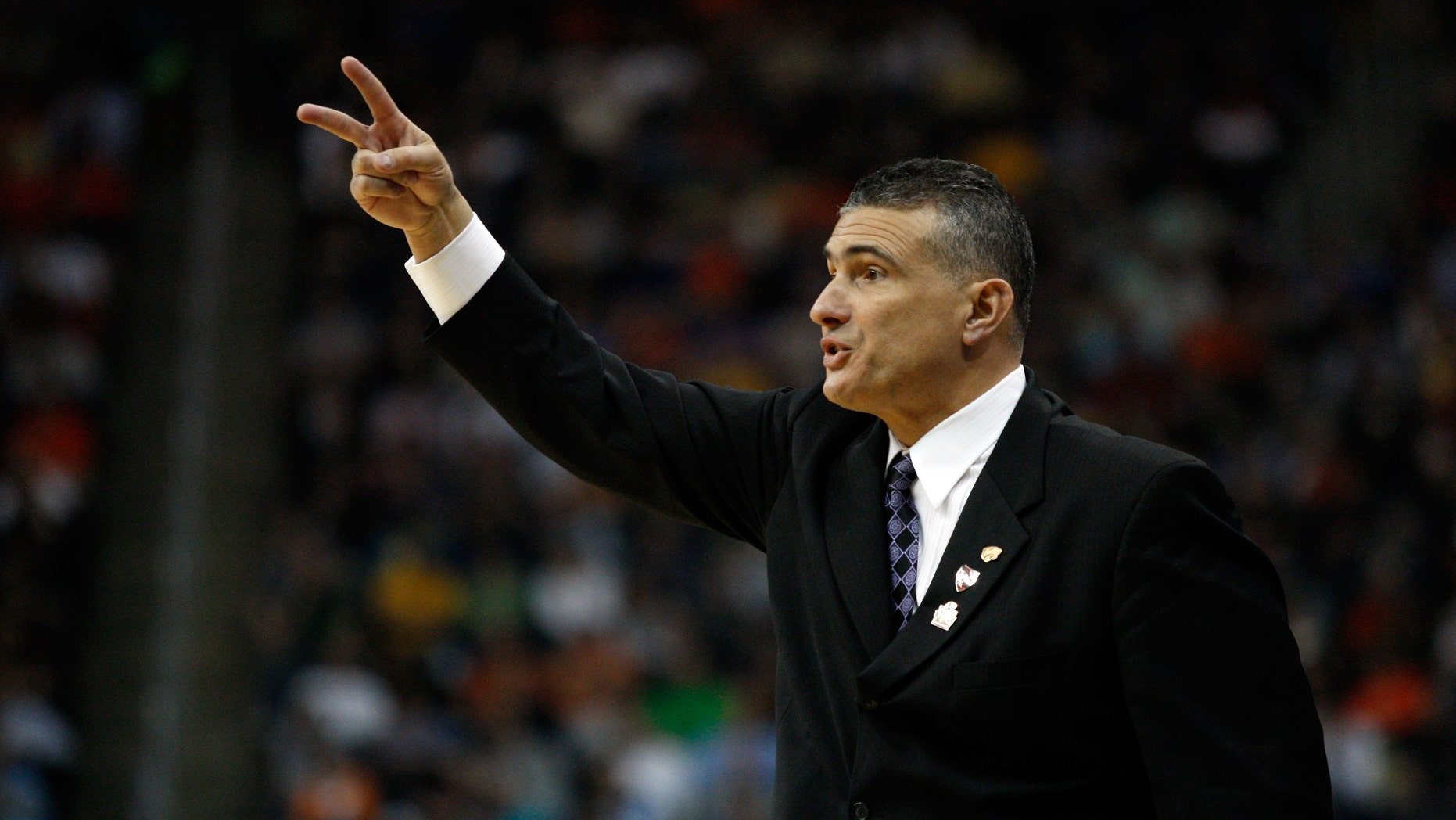 PITTSBURGH, PA - MARCH 15:  Head coach Frank Martin of the Kansas State Wildcats reacts against the Southern Miss Golden Eagles during the second round of the 2012 NCAA Men's Basketball Tournament at Consol Energy Center on March 15, 2012 in Pittsburgh, Pennsylvania.  (Photo by Jared Wickerham/Getty Images)