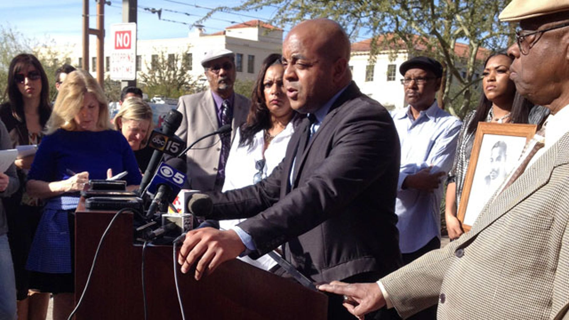 January 21, 2014: The Rev. Jarrett Maupin, center, an Arizona civil rights activist, speaks during a news conference in Phoenix to discuss accusations that an Arizona State University fraternity hosted a distasteful party in commemoration of Martin Luther King Jr. Day. Maupin is calling on the school to expel all students involved and permanently ban the Tau Kappa Epsilon fraternity from campus. (AP Photo/Brian Skoloff)