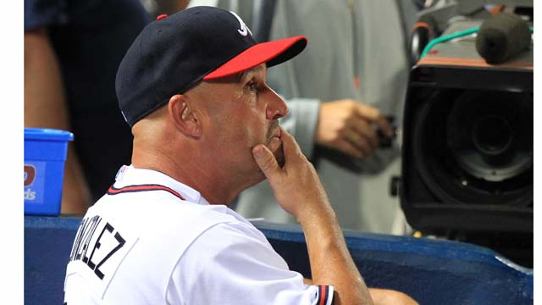 Atlanta Braves manager Fredi Gonzalez watches in the late innings of the team's 4-3 loss to the Philadelphia Phillies in a baseball game at Turner Field in Atlanta on Wednesday, Sept. 28, 2011. (AP Photo/Atlanta Journal-Constitution, Curtis Compton) GWINNETT OUT  MARIETTA OUT