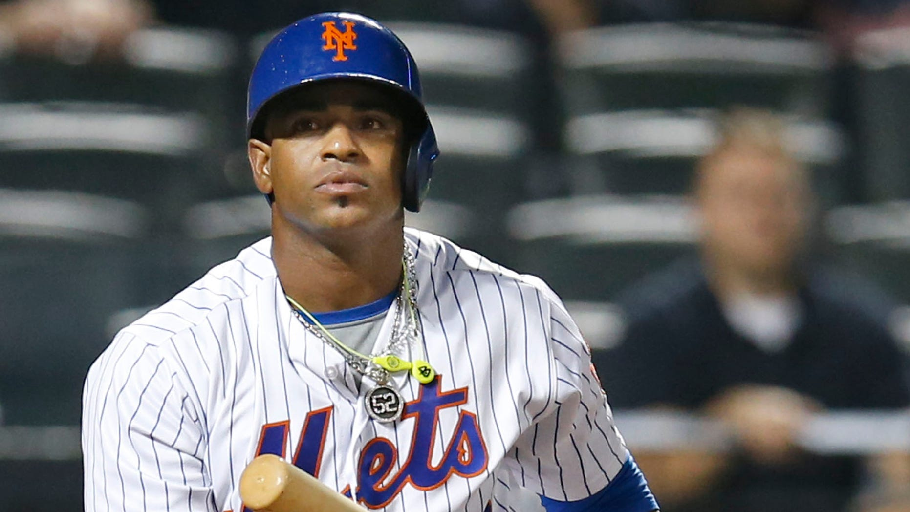 FILE - In this Sept. 20, 2016, file photo, New York Mets' Yoenis Cespedes reacts after striking out swinging for the final out in the Mets' 5-4 loss to the Atlanta Braves in a baseball game in New York.  Cespdes is expected to opt out of the remainder of his contract, which would pay $47.5 million over two seasons, and become a free agent again. (AP Photo/Kathy Willens, File)