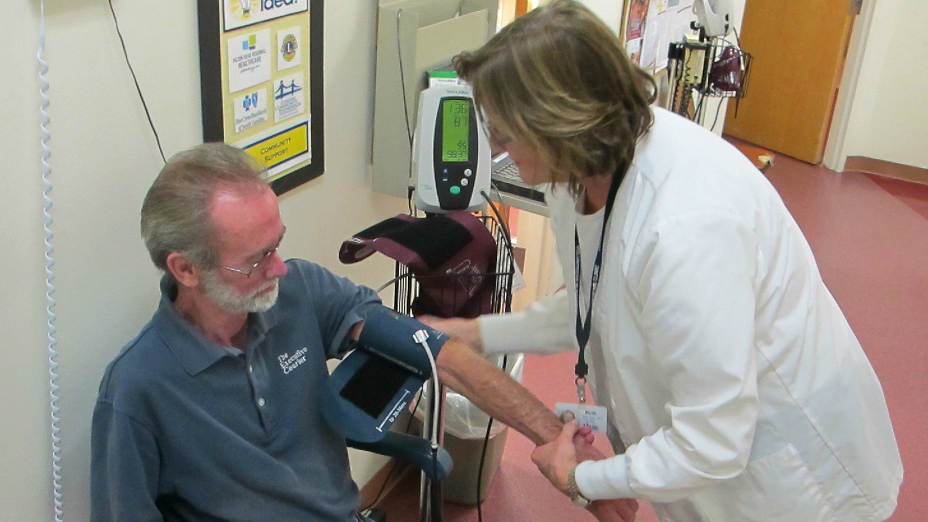 Jim Grant has his blood pressure taken by Beth Heyman at the Volunteers in Medicine Clinic on Hilton Head Island, S.C. The free clinic, staffed by retired physicians and nurses as well as volunteers, has become the model for 96 similar clinics nationwide. Last year, the nation's VIM clinics had 400,000 patient visits.