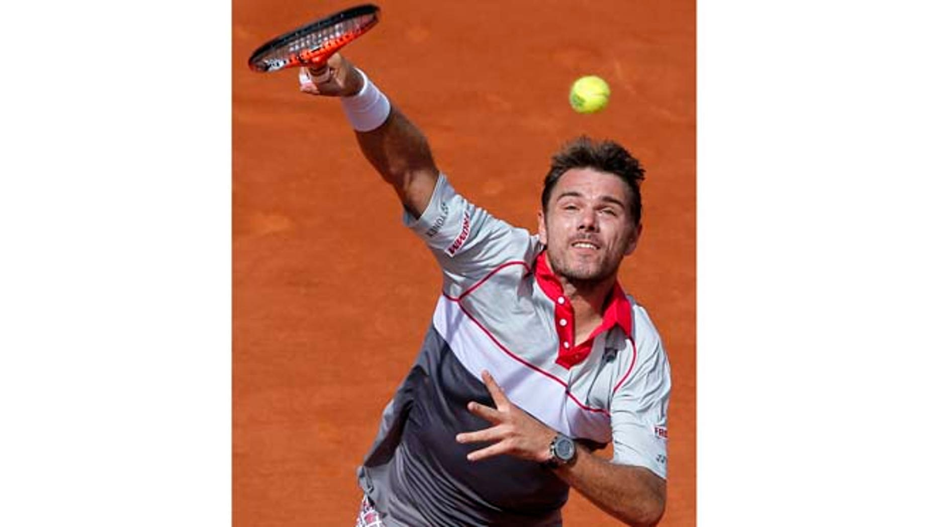 June 7, 2015: Switzerland's Stan Wawrinka serves the ball to Serbia's Novak Djokovic  during their final match of the French Open tennis tournament at the Roland Garros stadium in Paris.
