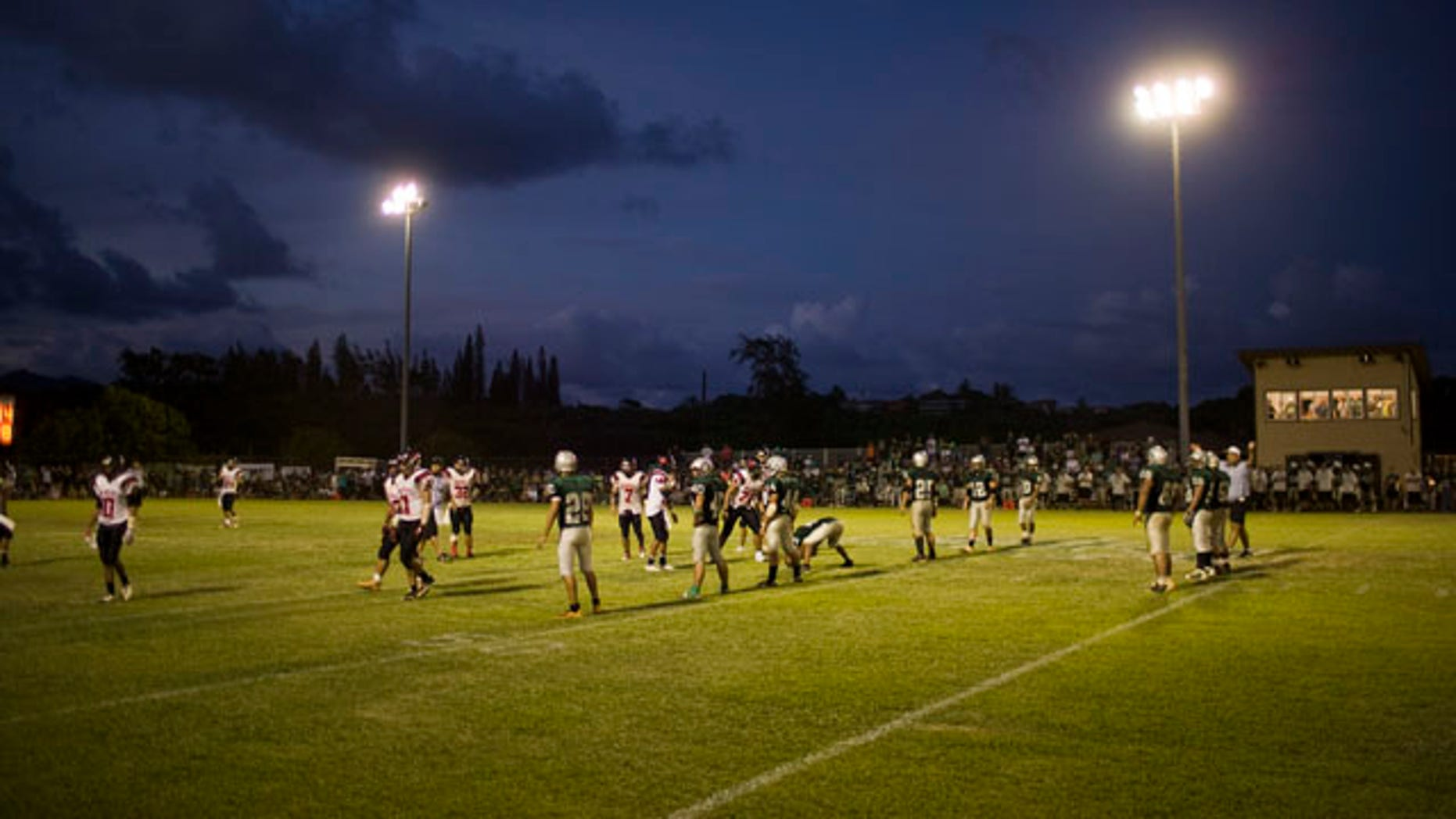 Oct. 16, 2010: Stadium lights shine down on a high school football game in Kapaa, Hawaii on the island of Kauai. Kauai high school football games, traditionally held on Friday nights, are now being played on Saturday afternoon due to a need to protect a threatened seabird which becomes disoriented during flight because of the bright stadium lights. The change has unsettled the community.