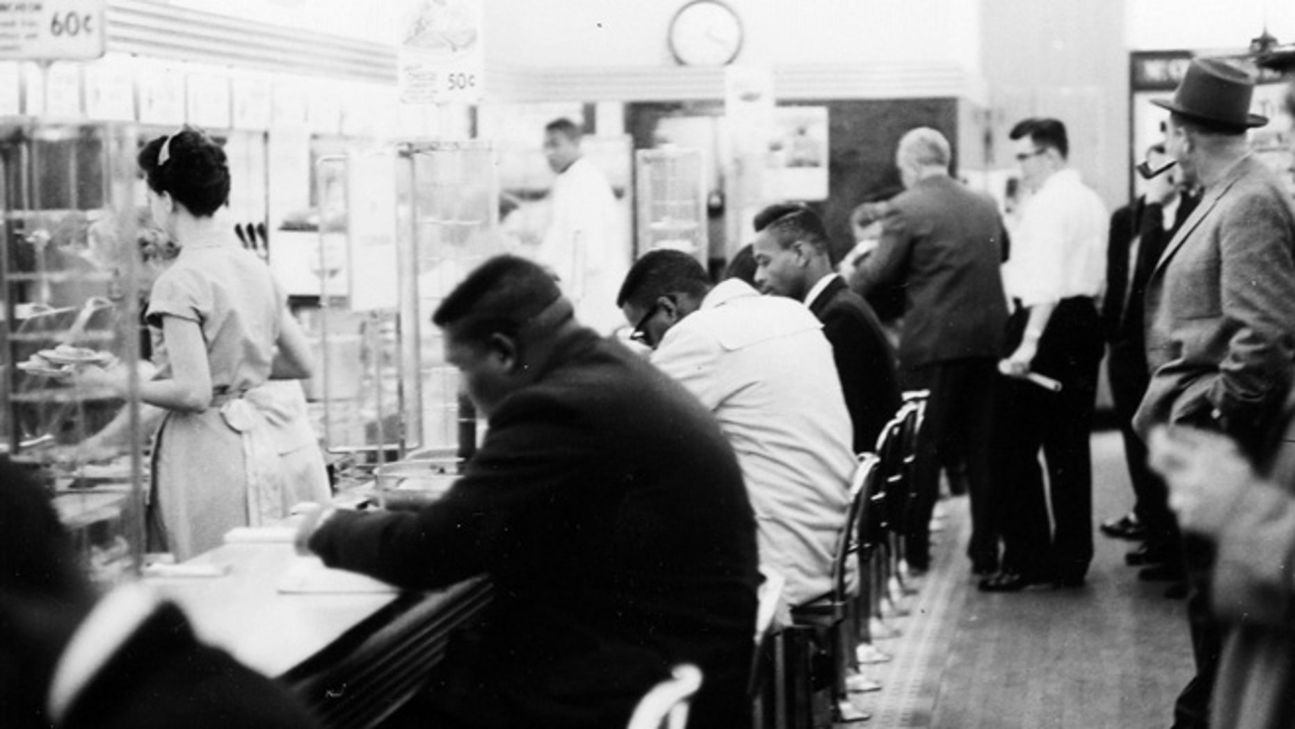 "February 1960: People take part in a civil rights ""sit-in"" protest at the lunch counter in McCrory's in Rock Hill, S.C."