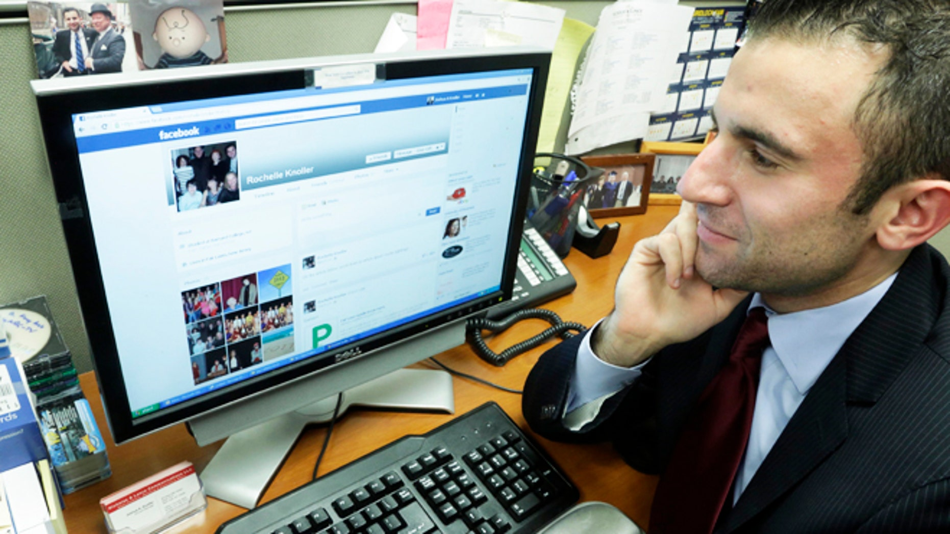 """May 9, 2013: Joshua Knoller, an account manager with Nicholas & Lence Communications, looks at the Facebook page of his mother, Rochelle Knoller of Fair Lawn, N.J., on his office computer, in New York. Knoller spent years refusing his mothers """"Friend Request"""" on Facebook before eventually """"caving in."""""""