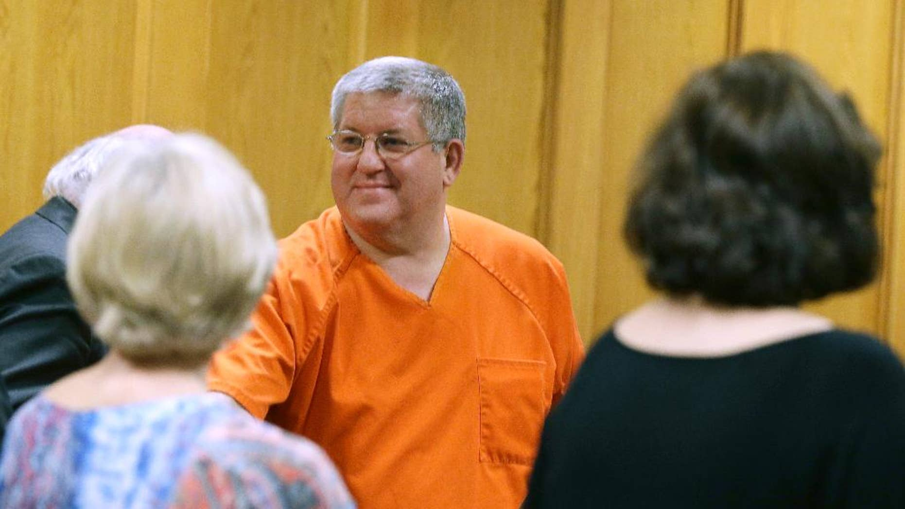 """File - In this May 6, 2014, file photo, Bernie Tiede smiles after a court hearing granting his release at the Panola County court house in Carthage, Texas.  Tiede had been sentenced to life for killing 81-year-old Marjorie Nugent. A state district judge is to hear pre-trial motions on Tuesday, March 31,2015, including one for the prosecutor's recusal, in the case that inspired the dark comedy """"Bernie."""" (AP Photo/LM Otero, File)"""