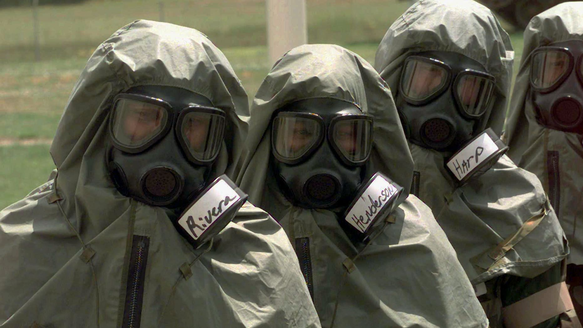 Army lieutenants listen during chemical training at the Chemical Decontamination Training Facility at Fort McClellan near Anniston, Ala. on Tuesday, May 20, 1997. The CDTF is the only U.S. military facility where live chemical training occurs. (AP Photo/Dave Martin)