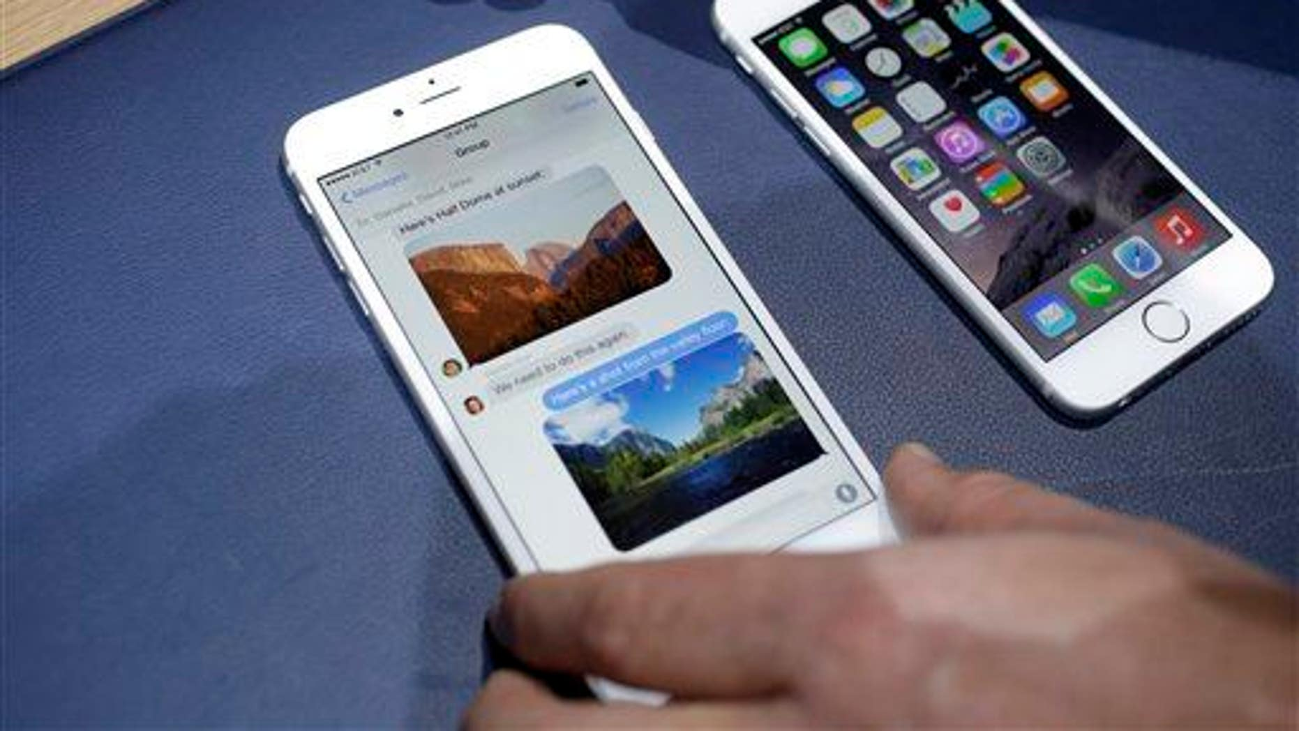 The iPhone 6 plus, left, and iPhone 6 are displayed on Tuesday, Sept. 9, 2014, in Cupertino, Calif.