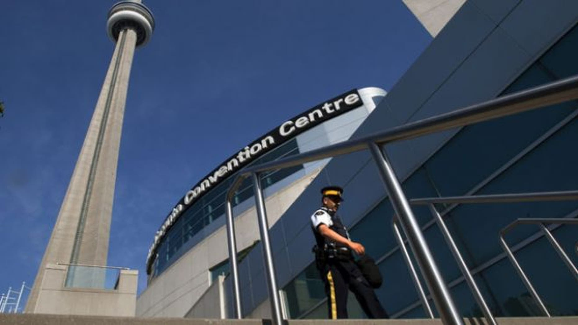 June 25, 2010: A Royal Canadian Mounted Police officer patrols outside the Metro Toronto Convention Center during the G20 summit (AP Photo/The Canadian Press, Frank Gunn)