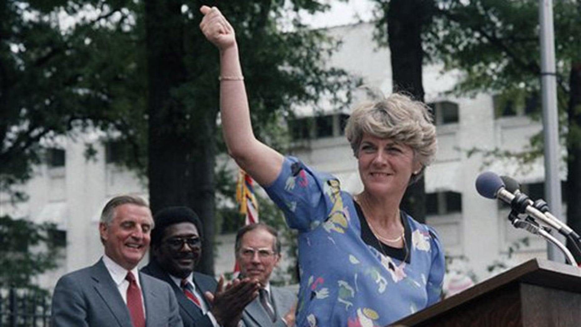 FILE - In this Wednesday, Aug. 1, 1984 file picture, Democratic vice presidential candidate Geraldine Ferraro gives the thumbs-up sign to a crowd of supporters in downtown Jackson, Miss. as Walter Mondale and Ferraro kicked off their 1984 campaign in this Southern city. Behind Ferraro are Mondale, state Rep. Robert Clark and former Gov. William Winter.
