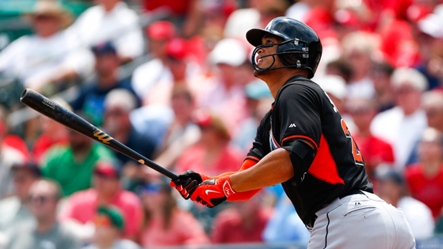 March 26: Miami Marlins' Giancarlo Stanton follows through with a home run in the first inning of an exhibition spring training baseball game against the St. Louis Cardinals.
