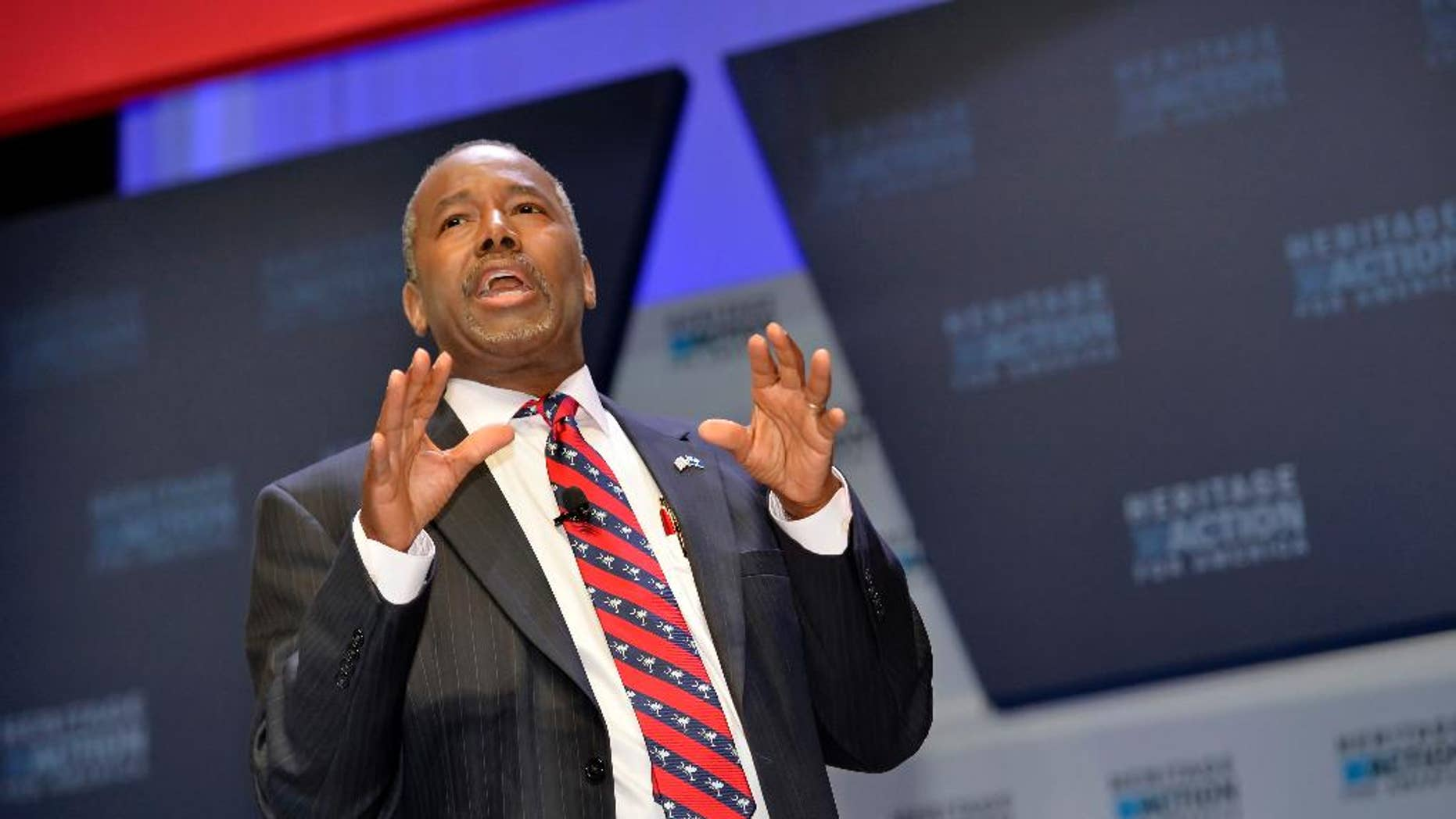 FILE - In this Sept. 18, 215 file photo, Republican presidential candidate Ben Carson speaks in Greenville, S.C. Carson is refusing to back off his weekend charge that Muslims shouldn't serve in the presidency. (AP Photo/Richard Shiro, File)