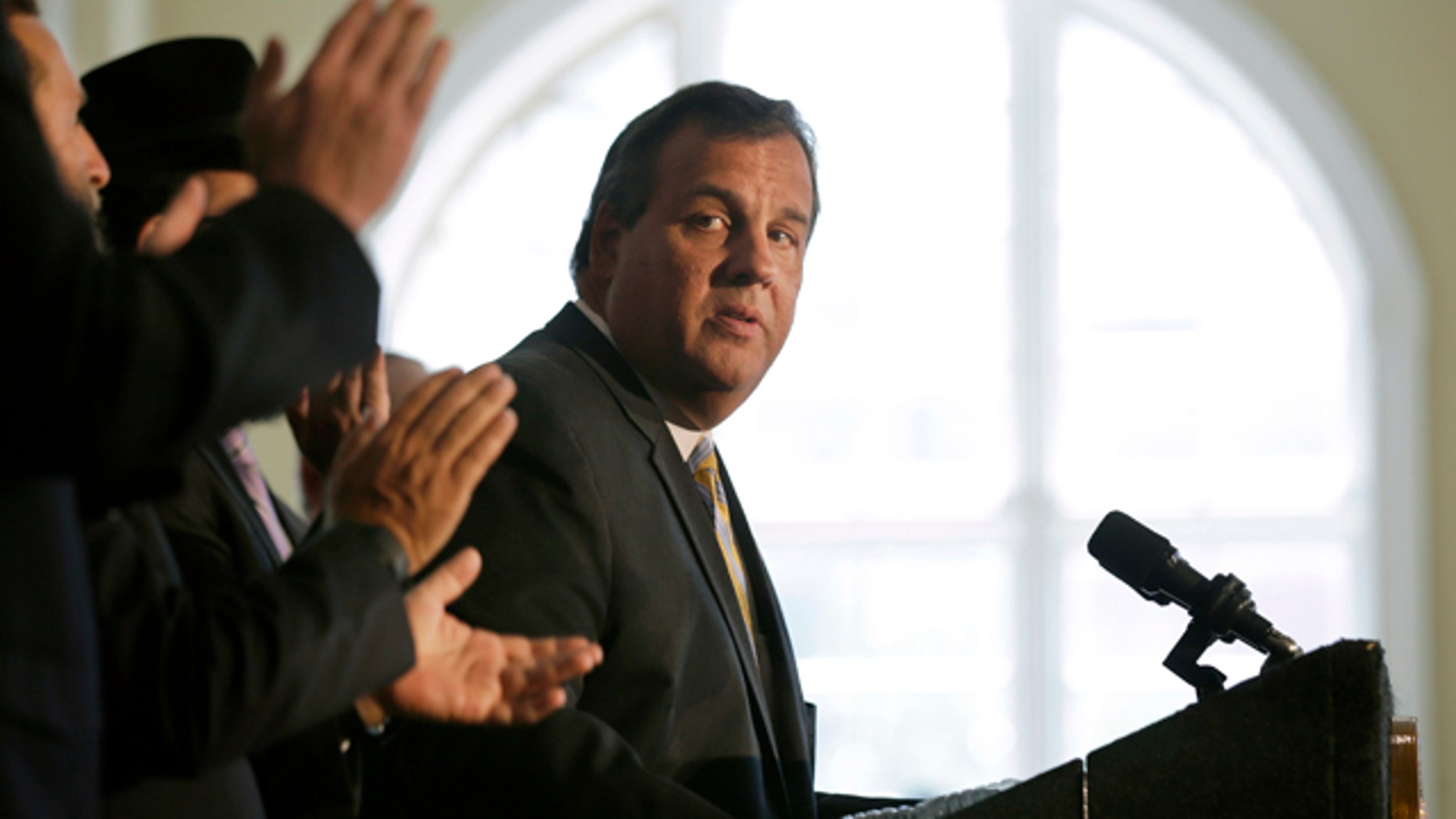 Aug. 25, 2015: New Jersey Gov. Chris Christie listens to applause after he called on Democratic Sen. Cory Booker and the state's congressional delegation to join Sen. Bob Menendez in opposing the Iran nuclear deal at Rutgers University in New Brunswick, N.J. (AP Photo/Mel Evans)