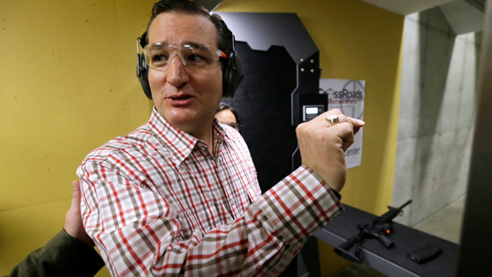 June 20, 2015: Republican presidential candidate, Sen. Ted Cruz, R-Texas, reacts after shooting a Smith & Wesson M-15 at the CrossRoads Shooting Sports in Johnston, Iowa. (AP Photo/Charlie Neibergall)