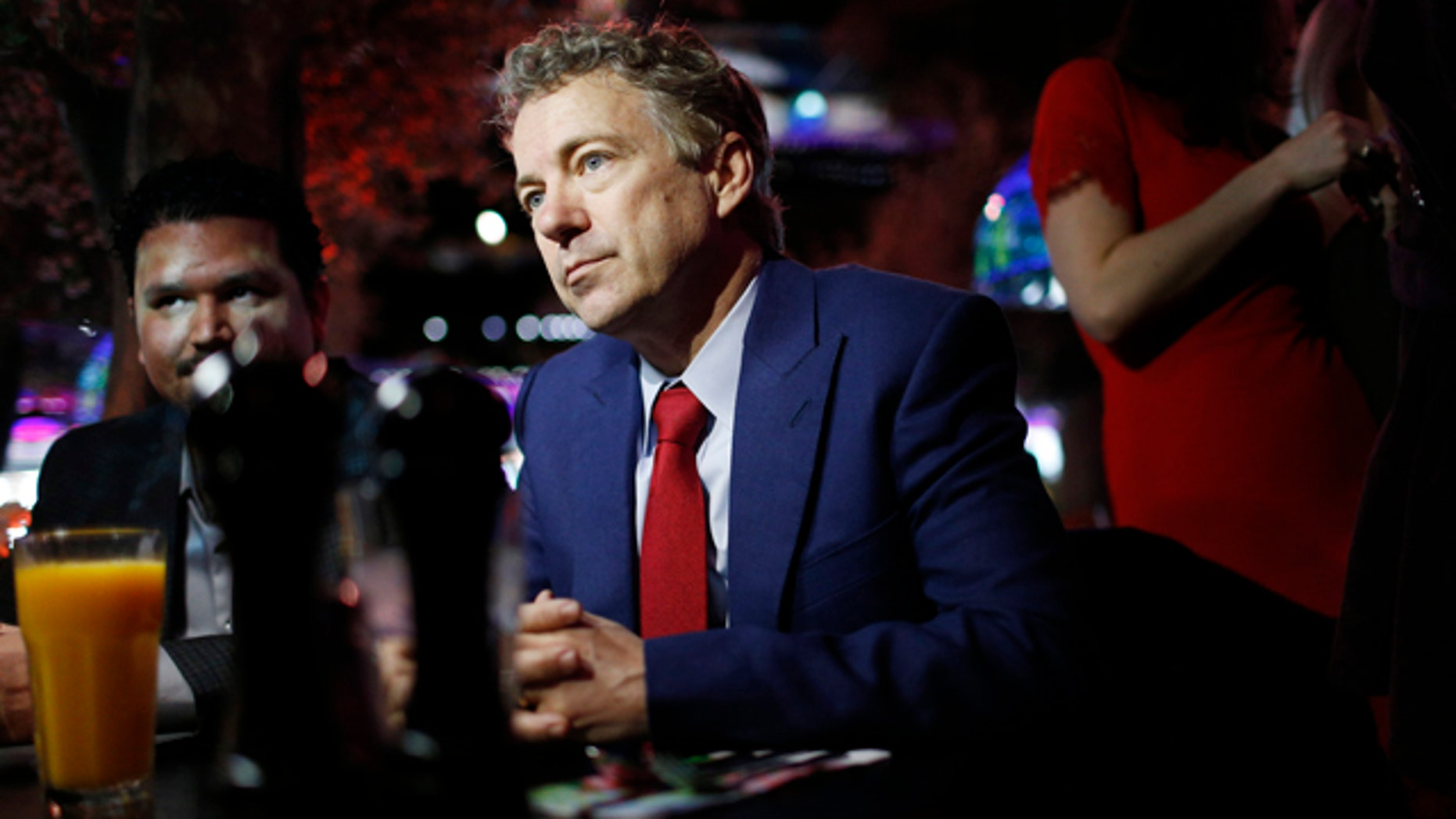 FILE - In this Jan. 16, 2015 file photo, Sen. Rand Paul, R-Ky.speaks with people at a restaurant in Las Vegas. (AP Photo/John Locher, File)