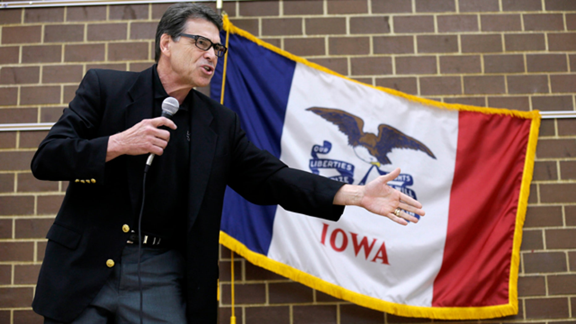 July 19, 2014: Texas Gov. Rick Perry speaks to local party activists in Algona, Iowa. (AP Photo/Charlie Neibergall)