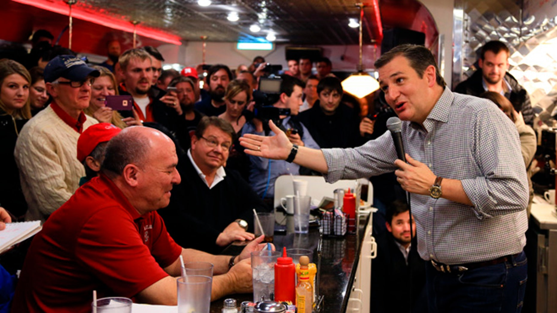 FILE - In this Jan 4, 2016 file photo, Republican Presidential candidate, Sen. Ted Cruz, R-Texas, campaigns at Penny's Diner in Missouri Valley, Iowa. Cruz and Marco Rubio are fighting for the favor of many of the same undecided voters across Iowa, where even some of the most attentive Republicans say they canât make up their minds less than four weeks before voting begins. (AP Photo/Nati Harnik, File)