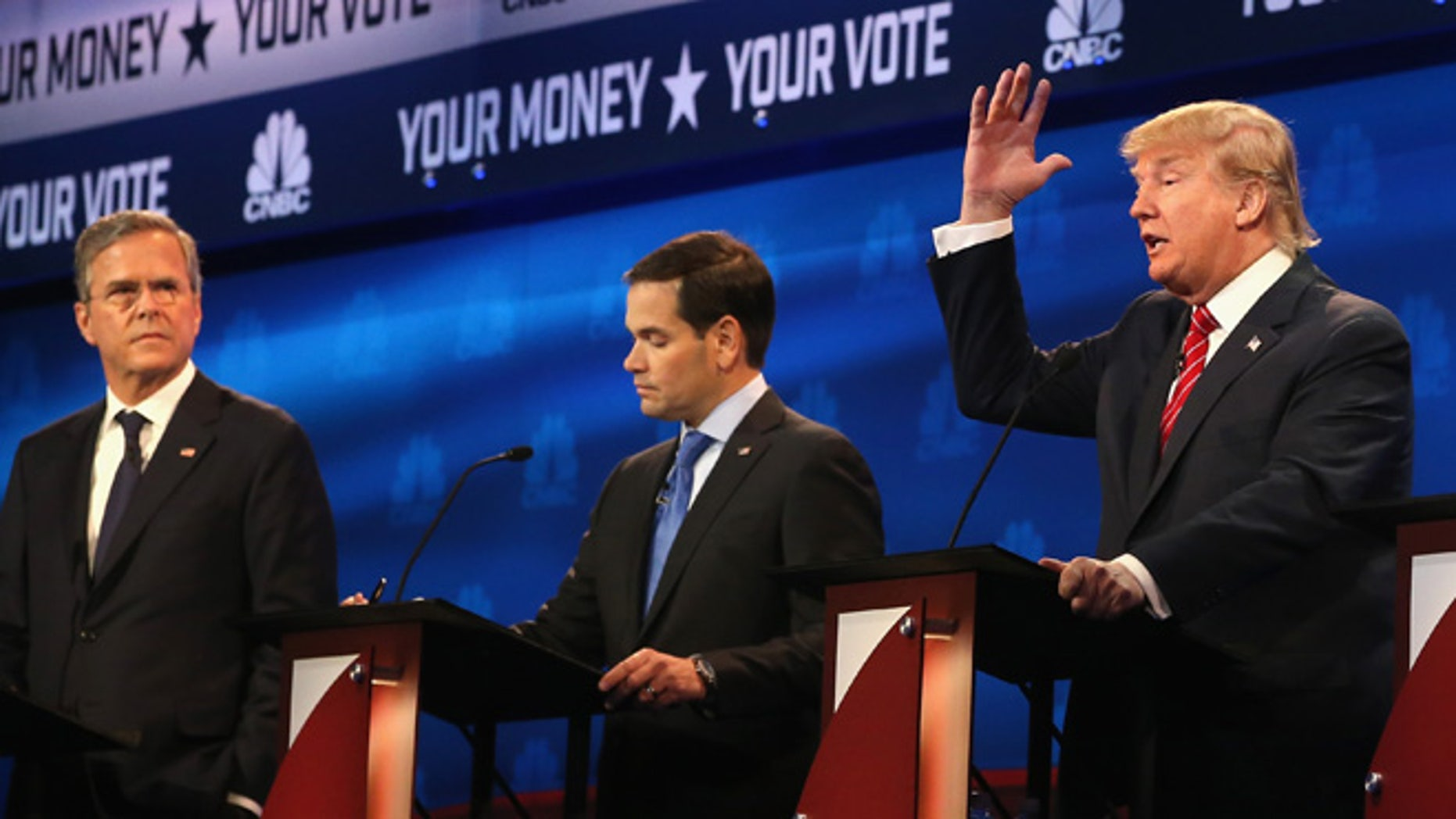 Presidential candidates Donald Trump speaks while Sen. Marco Rubio (R-FL) and Jeb Bush look on during the CNBC Republican Presidential Debate at University of Colorado's Coors Events Center October 28, 2015 in Boulder, Colorado. (Photo by Justin Sullivan/Getty Images)