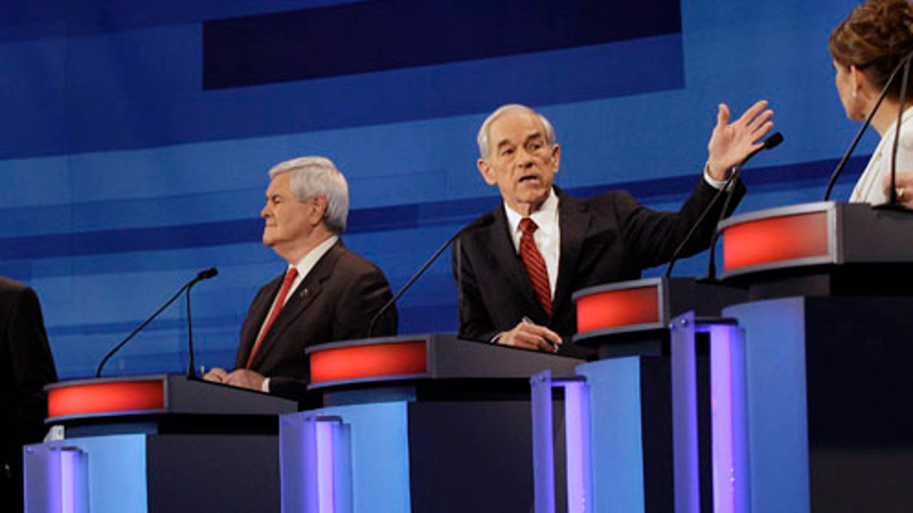 Republican presidential candidates from left, former Massachusetts Gov. Mitt Romney, former House Speaker Newt Gingrich, Rep. Ron Paul, R-Texas, and Rep. Michele Bachmann, R-Minn.,  participate in a Republican presidential debate in Sioux City, Iowa, Thursday, Dec. 15, 2011. (AP Photo/Eric Gay, Pool)