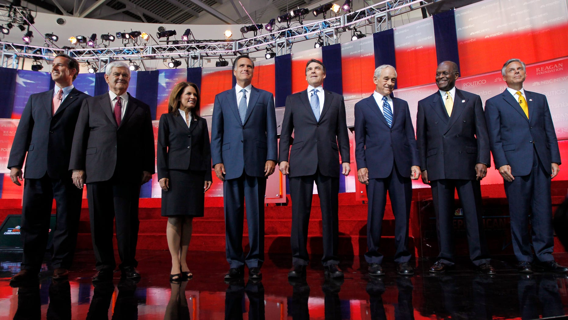 In this Sept. 7, 2011, file photo Republican presidential candidates stand together before a Republican presidential candidate debate at the Reagan Library in Simi Valley, Calif.