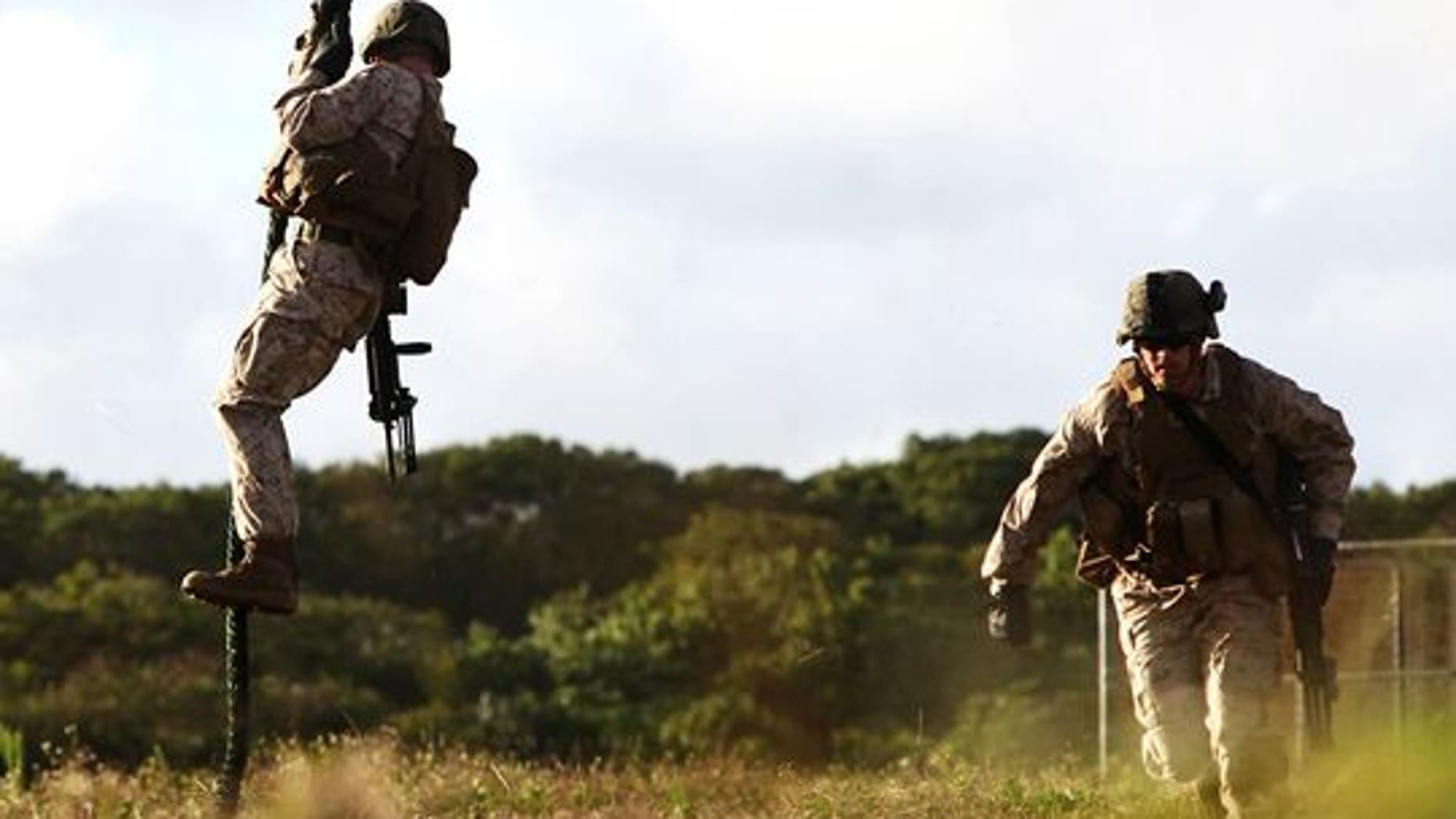 Marines fast-rope out of a helicopter during a training exercise in Guam. (Credit: Lance Cpl. Jenkins/Marine Corps)