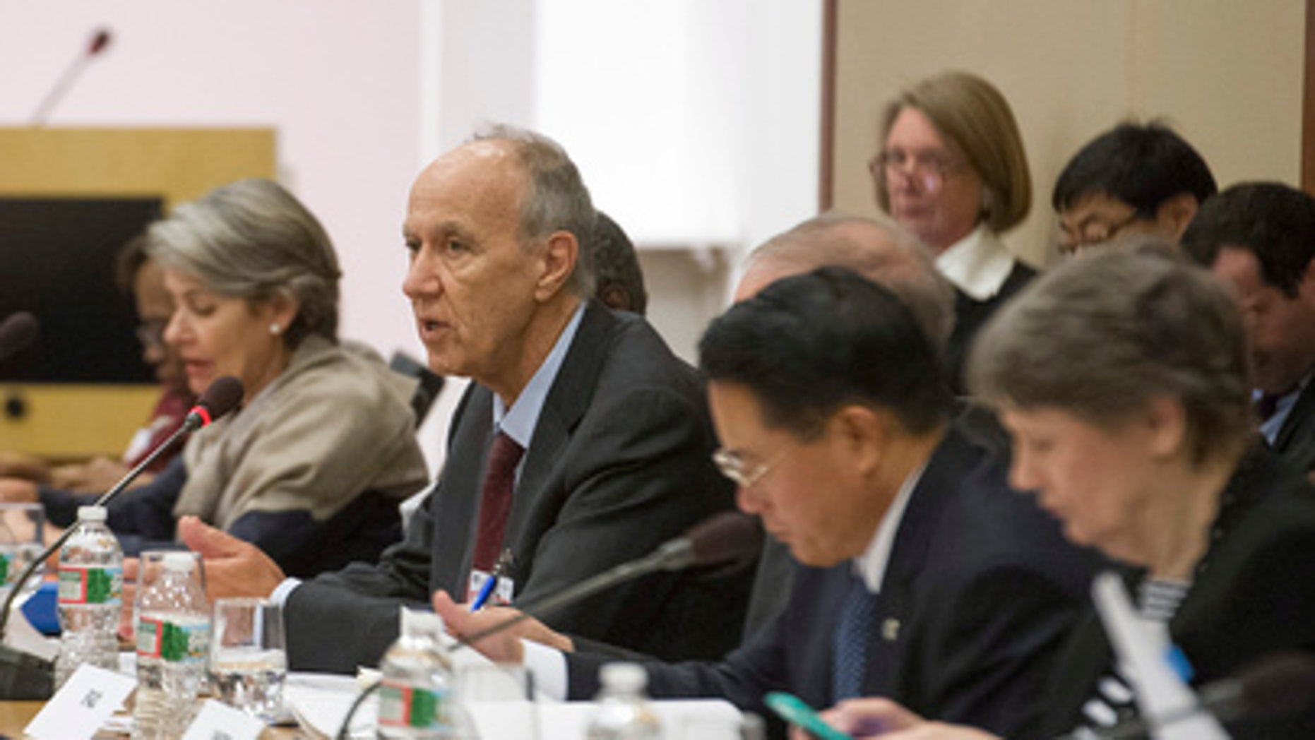 Francis Gurry, center, director-general of the World Intellectual Property Organization (WIPO), addresses the United Nations Chief Executives Board (CEB) in Washington, D.C., at a November 2014 meeting. (Credit: UN Photo/Eskinder Debebe)