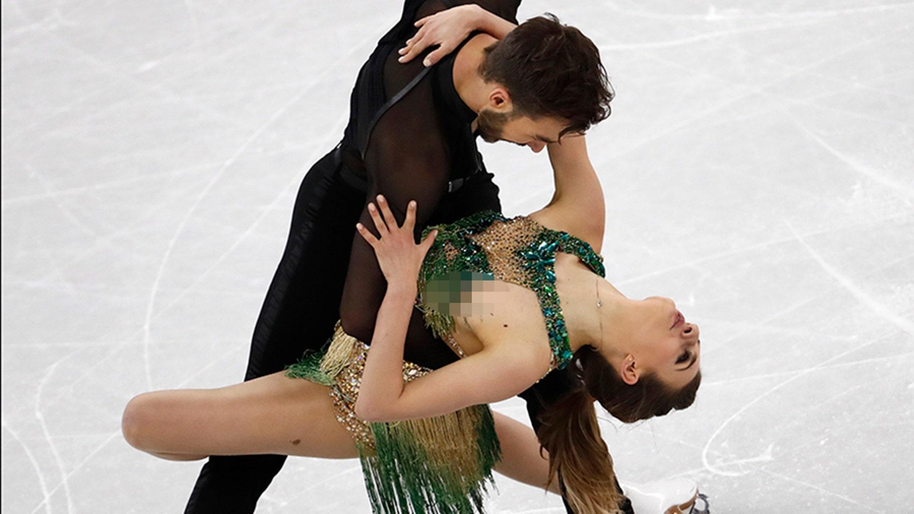 Gabriella Papadakis had a wardrobe malfunction during her short program with partner Guillaume Cizeron