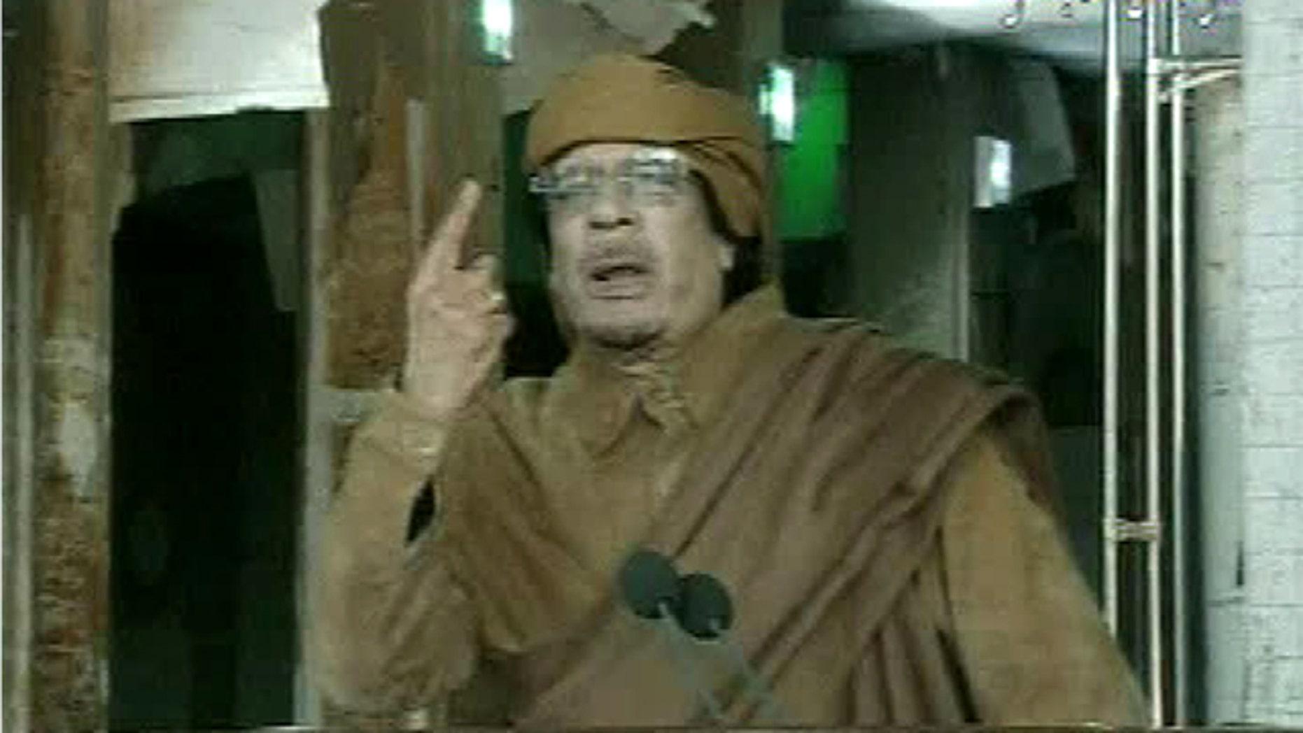 Feb. 22, 2011: This image broadcast on Libyan state television shows Libyan leader Muammar al-Qaddafi as he addresses the nation in Tripoli, Libya.