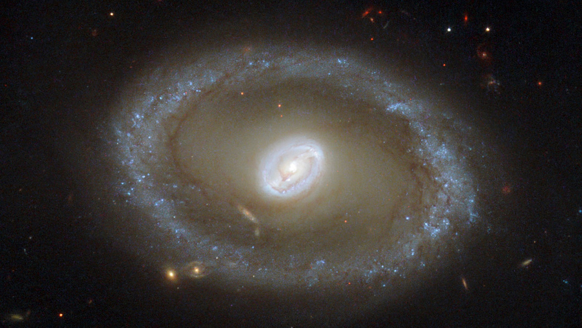 A galaxy known as NGC 3081 located over 86 million light-years from Earth is seen in an undated NASA/ESA Hubble Space Telescope image.