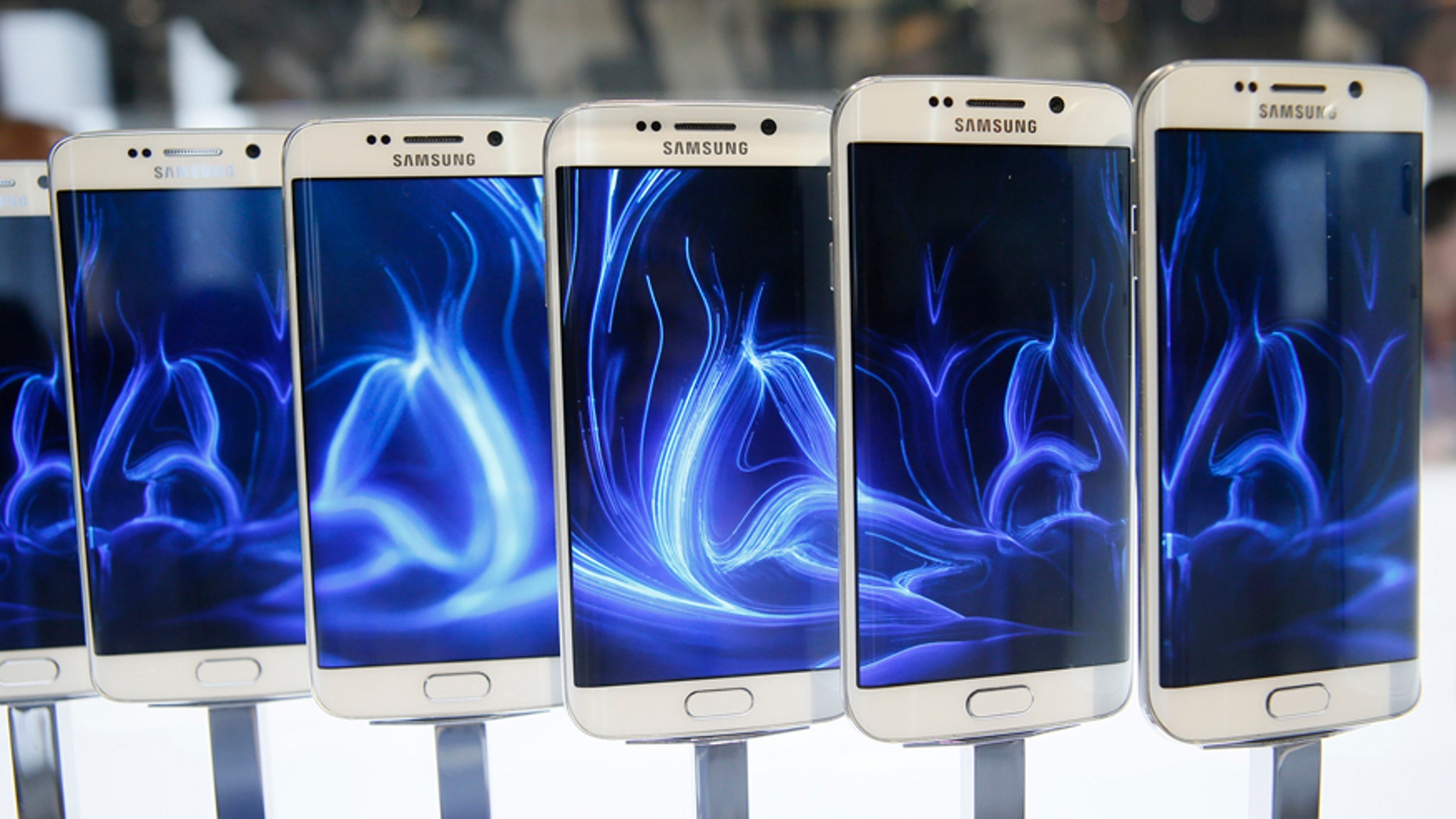 A row of Galaxy S6 edge smartphones are seen on display after the Samsung Galaxy Unpacked event before the Mobile World Congress in Barcelona March 1, 2015.
