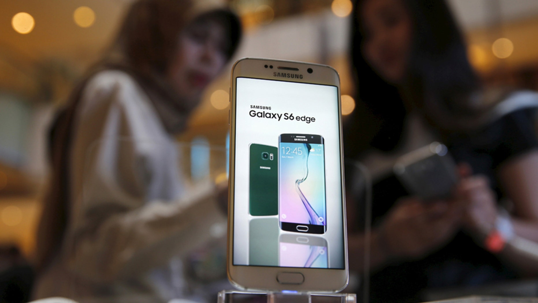 File photo - A Samsung Galaxy S6 edge is pictured while a salesperson (R) talks to a customer, as the Galaxy S6 and Galaxy S6 Edge go on sale to the public, at the Grand Indonesia mall in Jakarta, Indonesia, May 8, 2015.