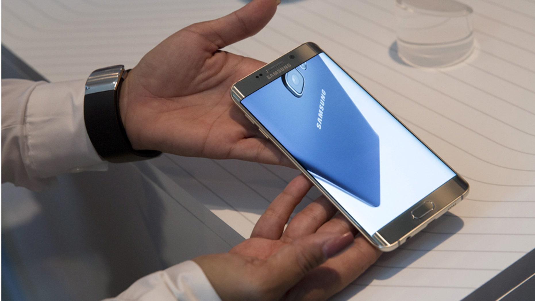 A product expert holds a Samsung Galaxy S6 Edge+ at the product's launch event in New York Aug. 13, 2015.
