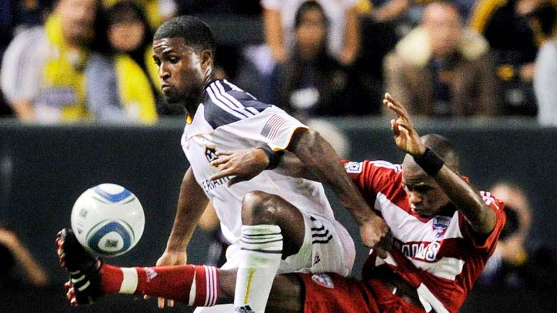 Los Angeles Galaxy forward Edson Buddle, left, and FC Dallas defender Jackson Goncalves battle for the ball during the first half of their MLS Western Conference Final playoff match, Sunday, Nov. 14, 2010, in Carson, Calif. (AP Photo/Mark J. Terrill)