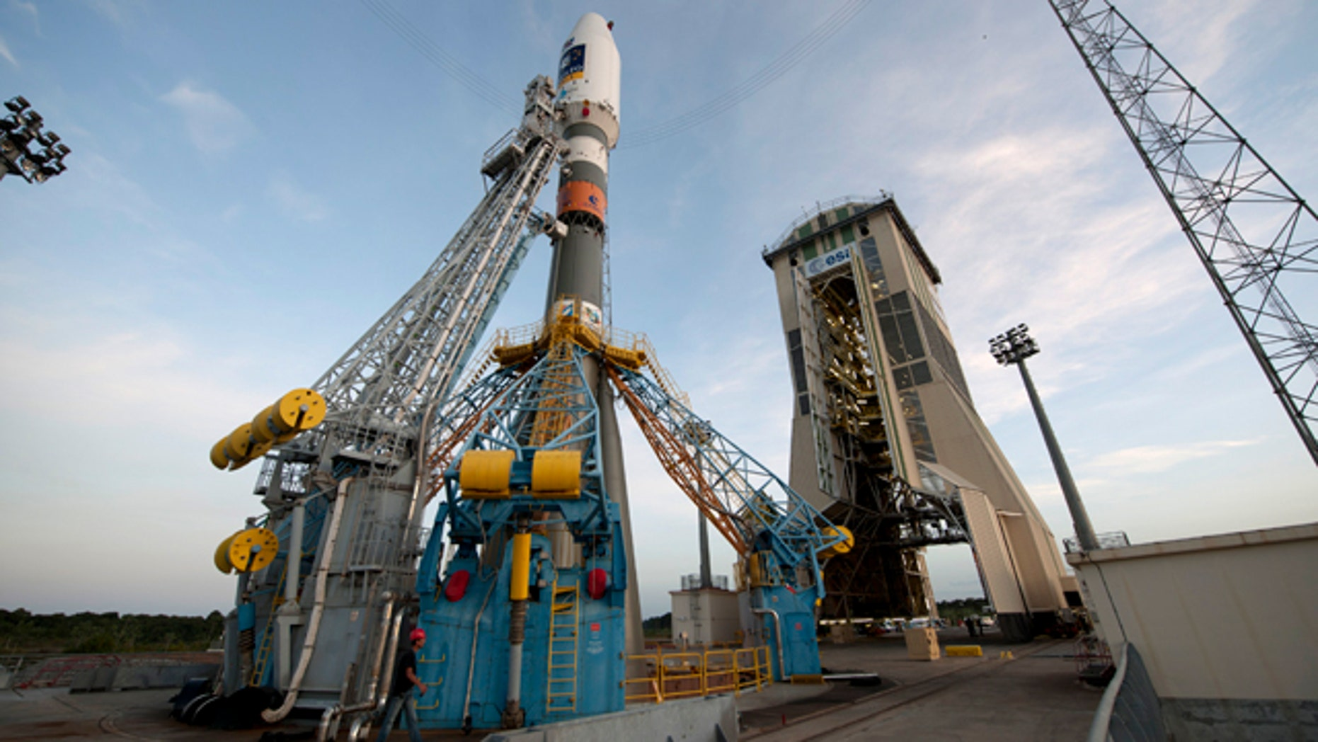Oct. 14, 2011: Soyuz VS01, the first Soyuz flight from Europes Spaceport in French Guiana, sits on the launchpad awaiting the green light to lift off.The vehicle was rolled out horizontally on its erector from the preparation building to the launch zone and then raised into the vertical position. The Upper Composite, comprising the Fregat upper stage, payload and fairing, was also transferred and added onto the vehicle from above, completing the very first Soyuz on its launch pad at Europes Spaceport.Soyuz VS01 will lift off on 20 October 2011. The rocket will carry the first two satellites of Europes Galileo navigation system into orbit.