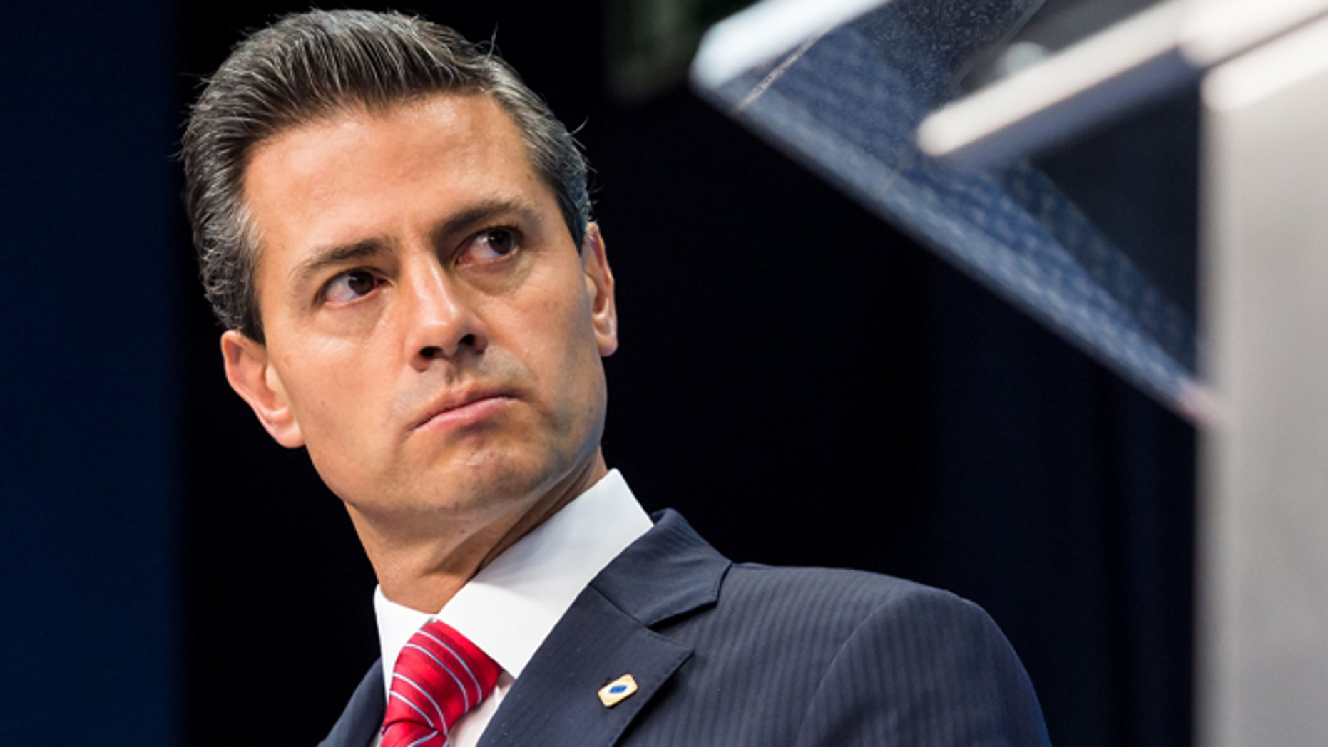FILE - In this June 12, 2015, file photo, Mexico's President Enrique Pena Nieto addresses the media during an EU Mexico summit at the EU Council building in Brussels. Pena Nieto has been released from the hospital on Sunday, June 28, after undergoing surgery to remove his gallbladder at Mexico's Central Military Hospital. (AP Photo/Geert Vanden Wijngaert, File)