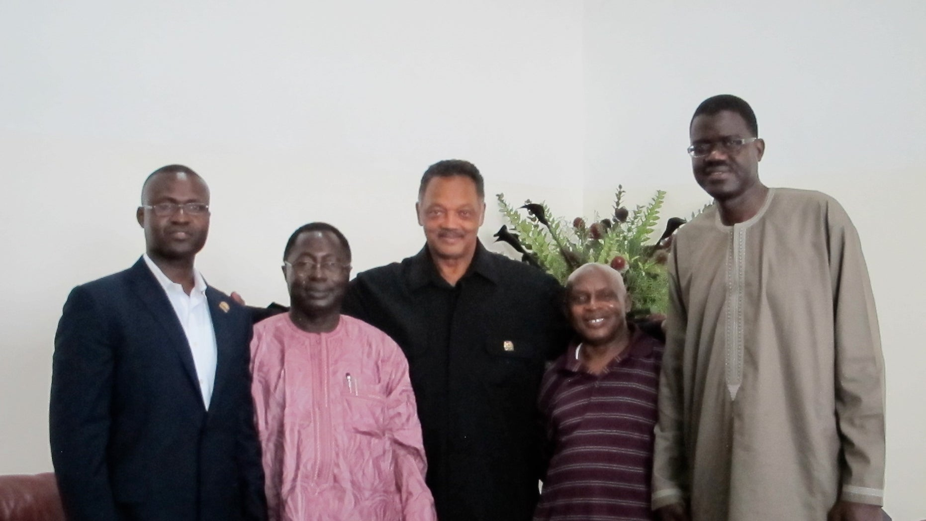 Rev. Jesse Jackson, Sr. pictured with Gambian officials.