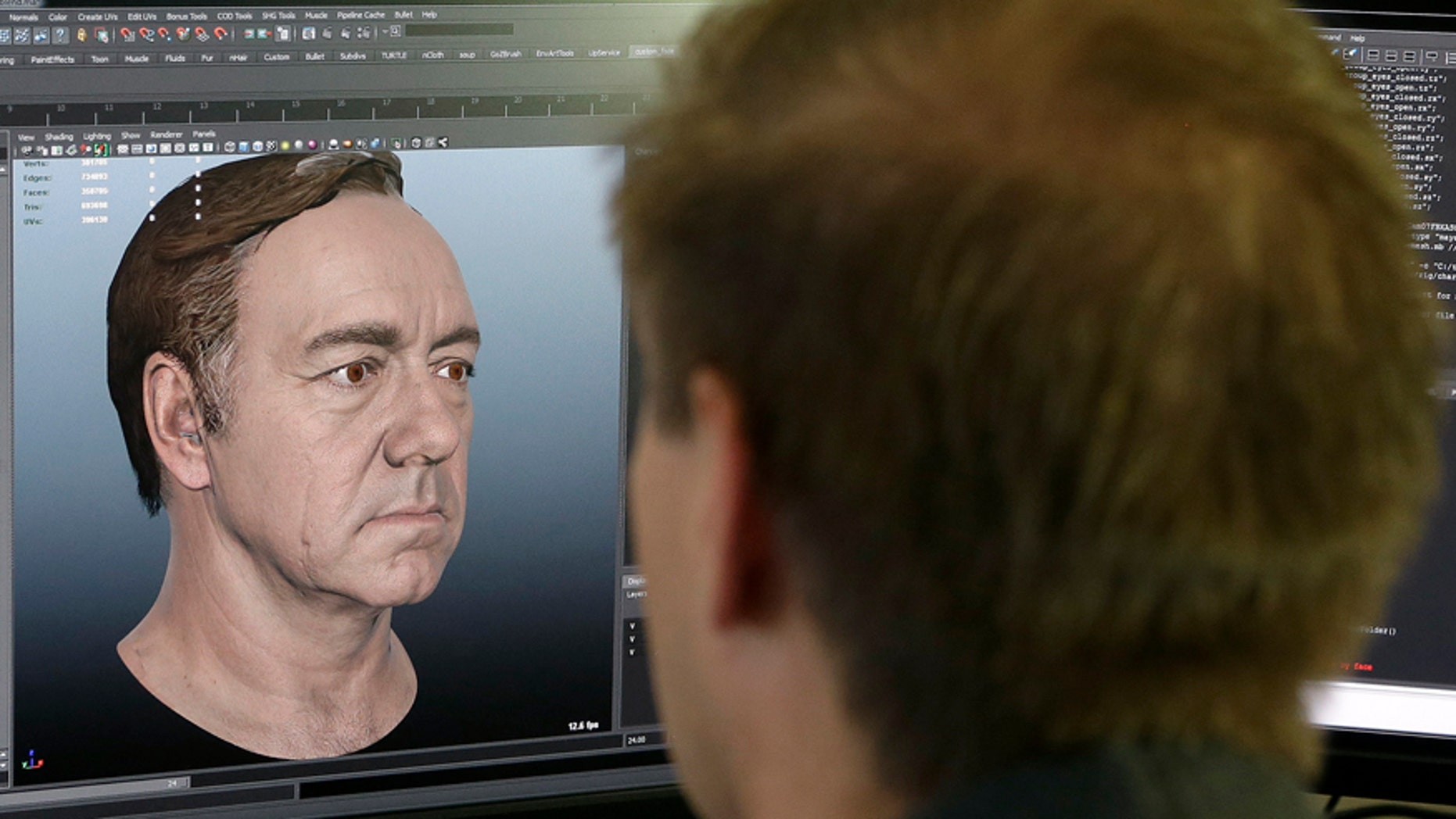 """This July 31, 2014 photo shows senior technical artist Mason Sheffield working on the face of actor Kevin Spacey for the new """"Call of Duty: Advanced Warfare"""" game at Sledgehammer Games in Foster City, Calif."""