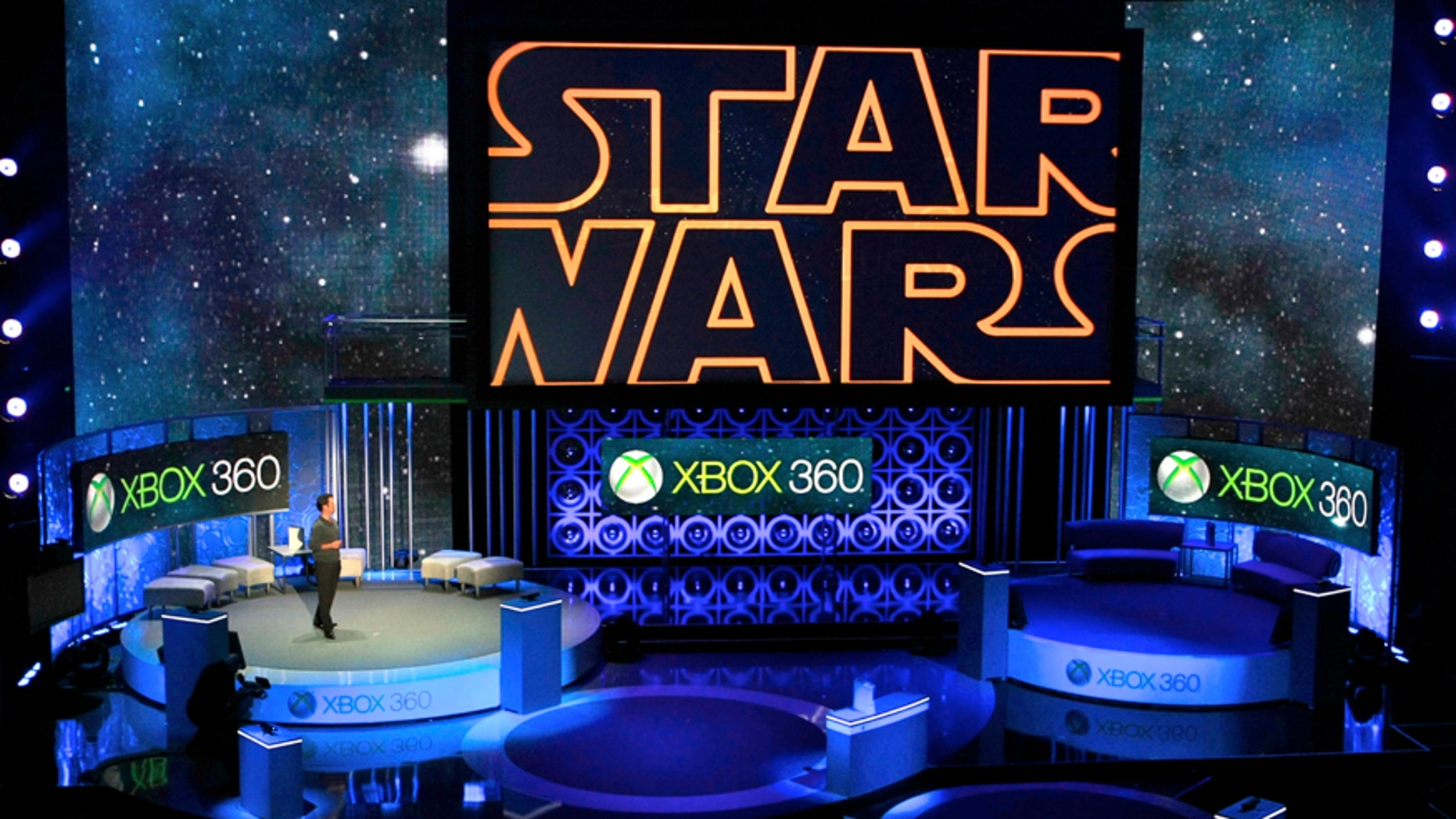 "In this June 14, 2010 file photo, Microsoft presents an upcoming LucasArts' ""Star Wars"" video game for its new Xbox 360 with Kinect technology, during the 2010 Xbox 360 media briefing at the Wiltern Theater, in Los Angeles."