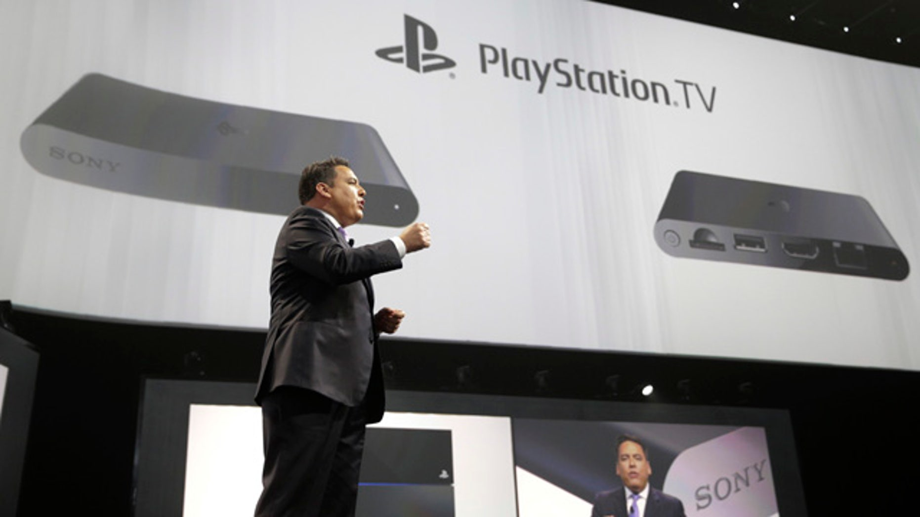 June 9, 2014: Shawn Layden, president and CEO of Sony Computer Entertainment America, introduces the PlayStation TV during a presentation at the Electronic Entertainment Expo in Los Angeles. (AP Photo/Jae C. Hong)